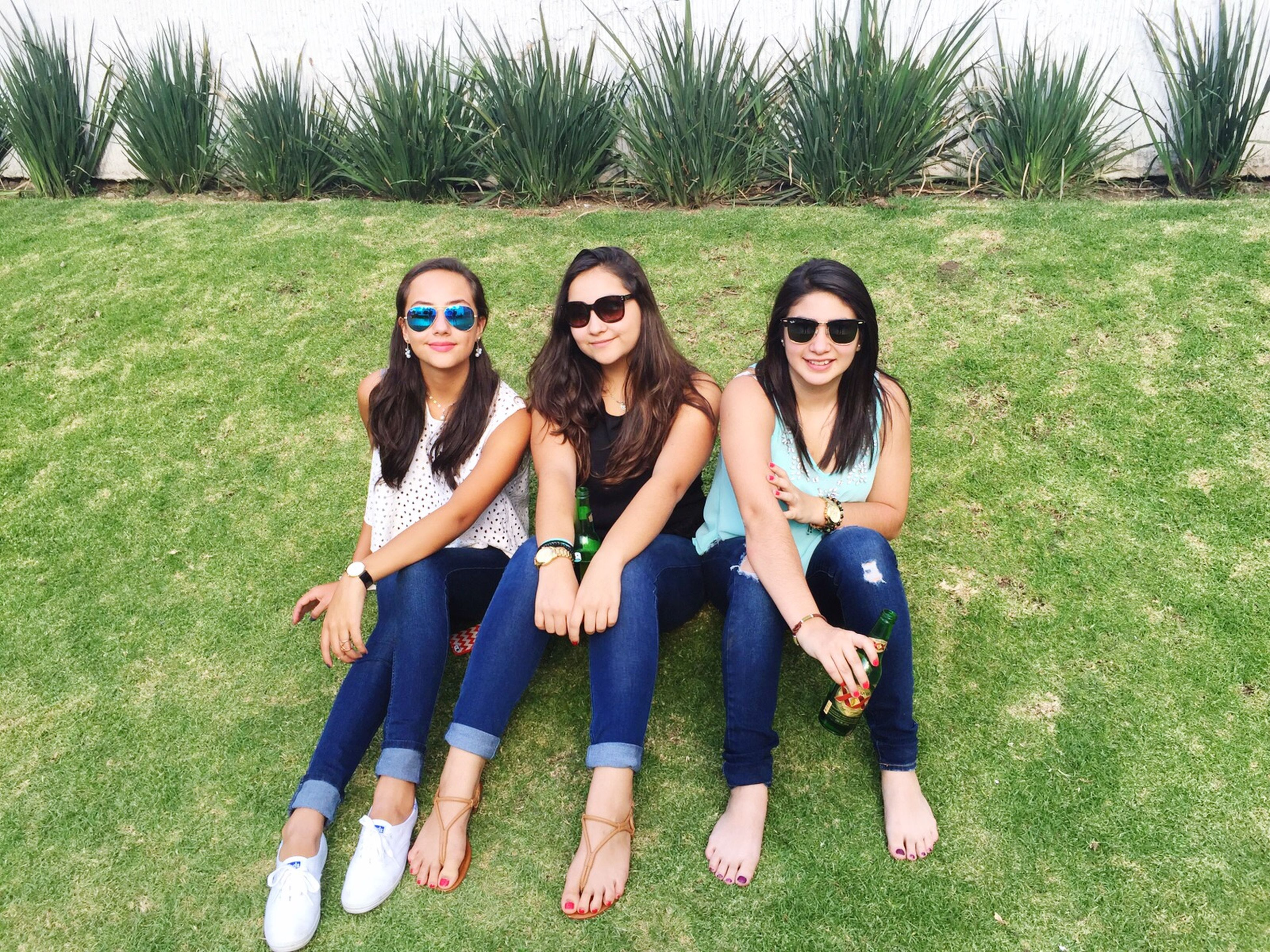 togetherness, lifestyles, leisure activity, bonding, young adult, person, casual clothing, grass, friendship, smiling, love, young women, happiness, front view, portrait, looking at camera, standing