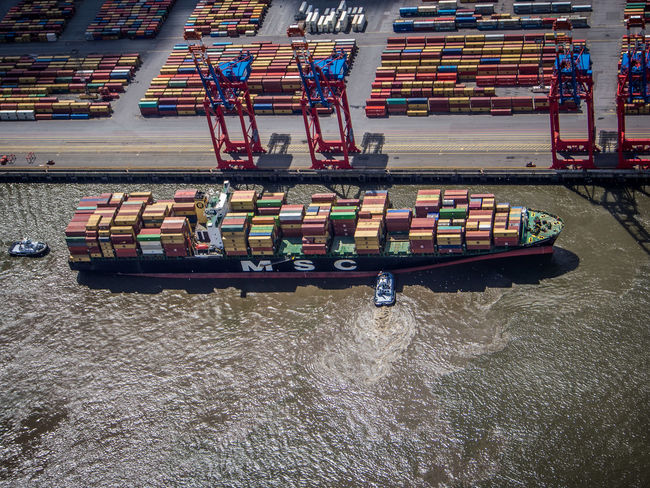 Parking Position at the Container Terminal Bugsier Container Container Ship Container Terminal Cranes Elbe Elbe River Elevated View From Above  Hamburg Harbor Harbour Intermodal Mode Of Transport Nautical Vessel Parking Position Port Rippled Terminal Vessel Water A Bird's Eye View