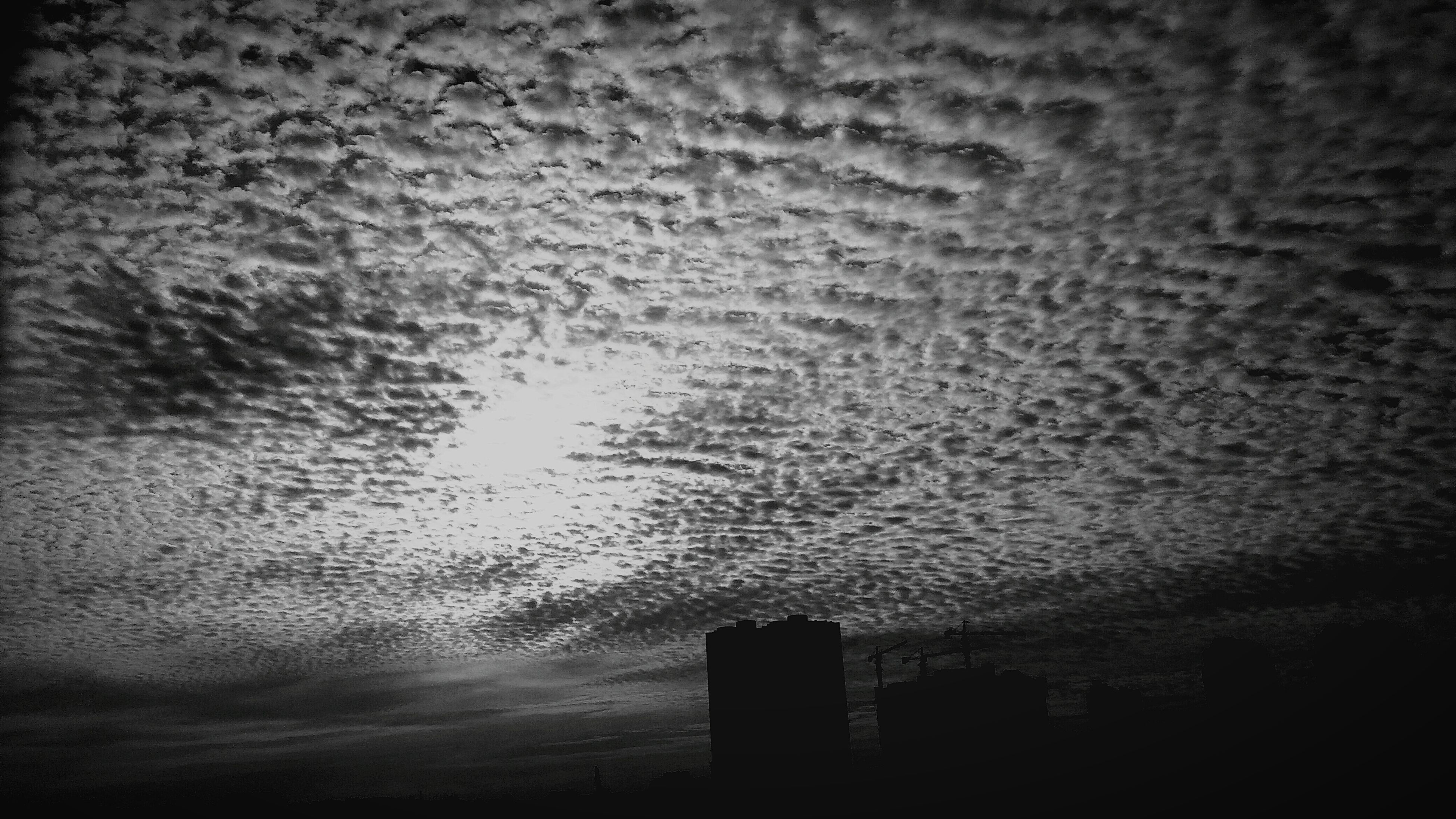 architecture, built structure, building exterior, silhouette, sky, cloud - sky, water, dusk, city, outdoors, nature, weather, no people, building, sunset, cloudy, low angle view, tranquility, overcast, scenics