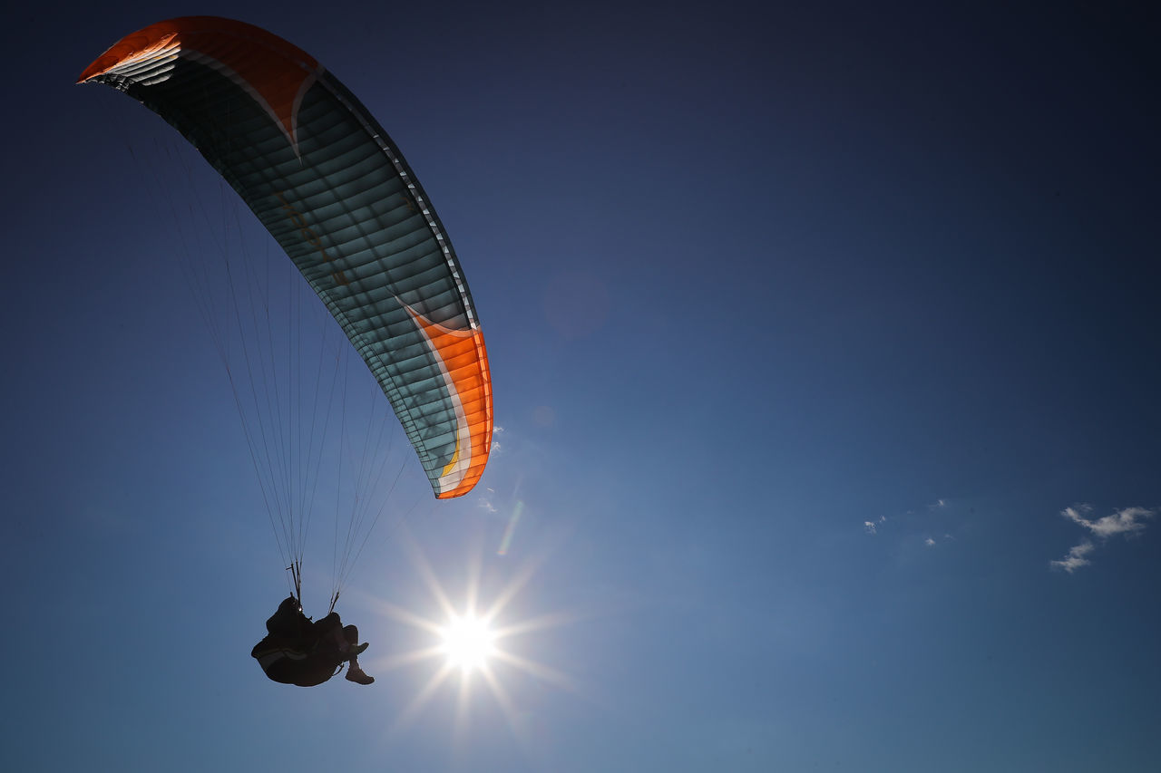 Adult Adults Only Adventure Clear Sky Day Extreme Sports Flying Freedom Leisure Activity Low Angle View One Man Only One Person Only Men Outdoors Parachute Paragliding People Sky Sunlight