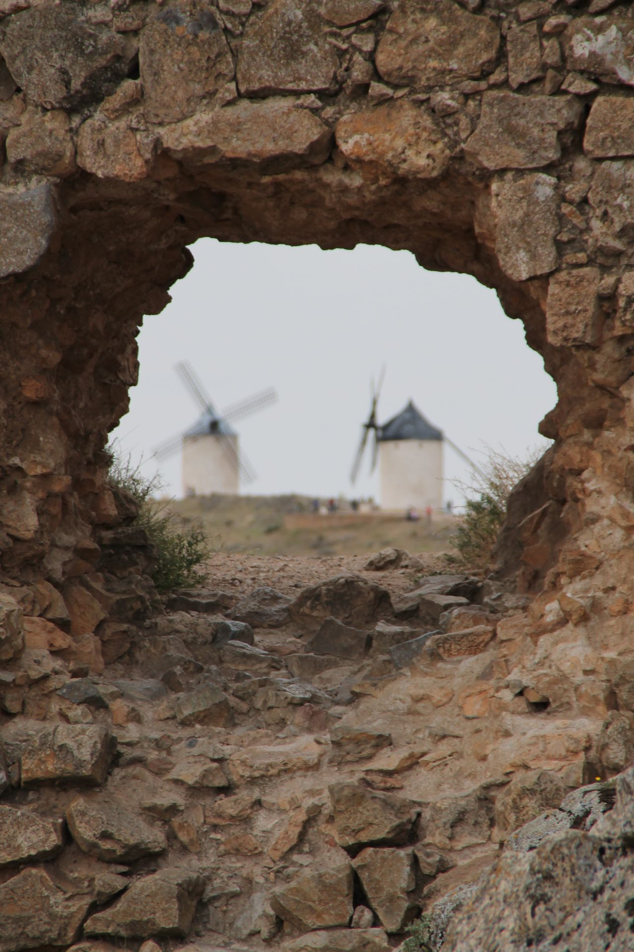 Built Structure Architecture Building Exterior No People Day Outdoors Nature Tree Sky Rural Scene Technology Nature Traditional Windmill Architecture Hanging Out Check This Out Travel Destinations Taking Photos La Mancha Consuegra Windmill Wind Power Wall Stone Wall Window