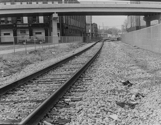 """The Wrong Side of the Tracks""Ilford HP5 Plus 400Silver Gelatin PrintScanned 11x14 print Epson scannerLightroom: cropped & straightened Black & White Train Tracks Olympusom1n Silvergelatinprint B&w Street Photography Depth Of Field"
