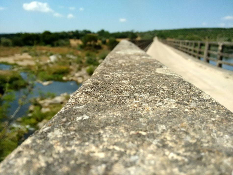 Wall Summer 2016 Summertime Walking On Sunshine Portugal Is Beautiful Alentejo,Portugal Nature Açude Bridge View Sunny Day River Alentejo Textures And Surfaces Rocks EyeEm Nature Lover EyeEm Best Shots - Nature EyeEm