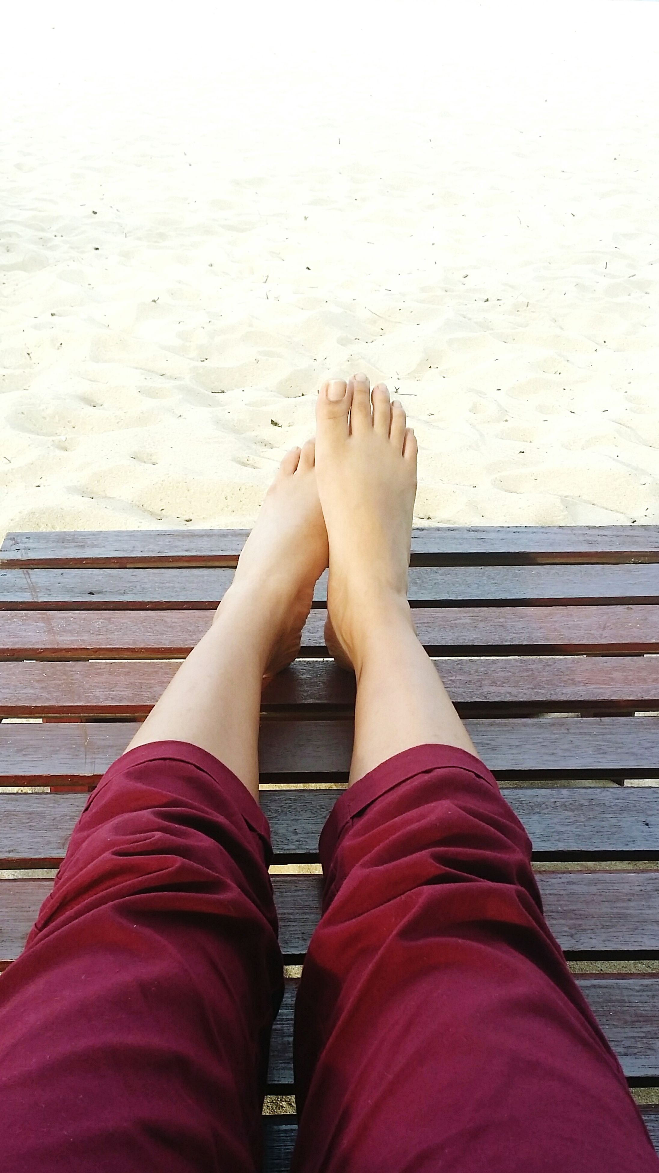 low section, person, relaxation, personal perspective, vacations, beach, day, outdoors, water, tourism, resting, sea