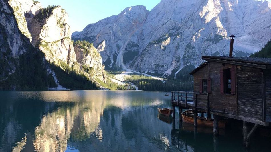 Water Architecture Built Structure Mountain House Building Exterior Lake Waterfront Tranquil Scene Scenics Tranquility Reflection Majestic Mountain Range Beauty In Nature Idyllic Pier Nature Calm Remote Alps Lake View Atmosphere In
