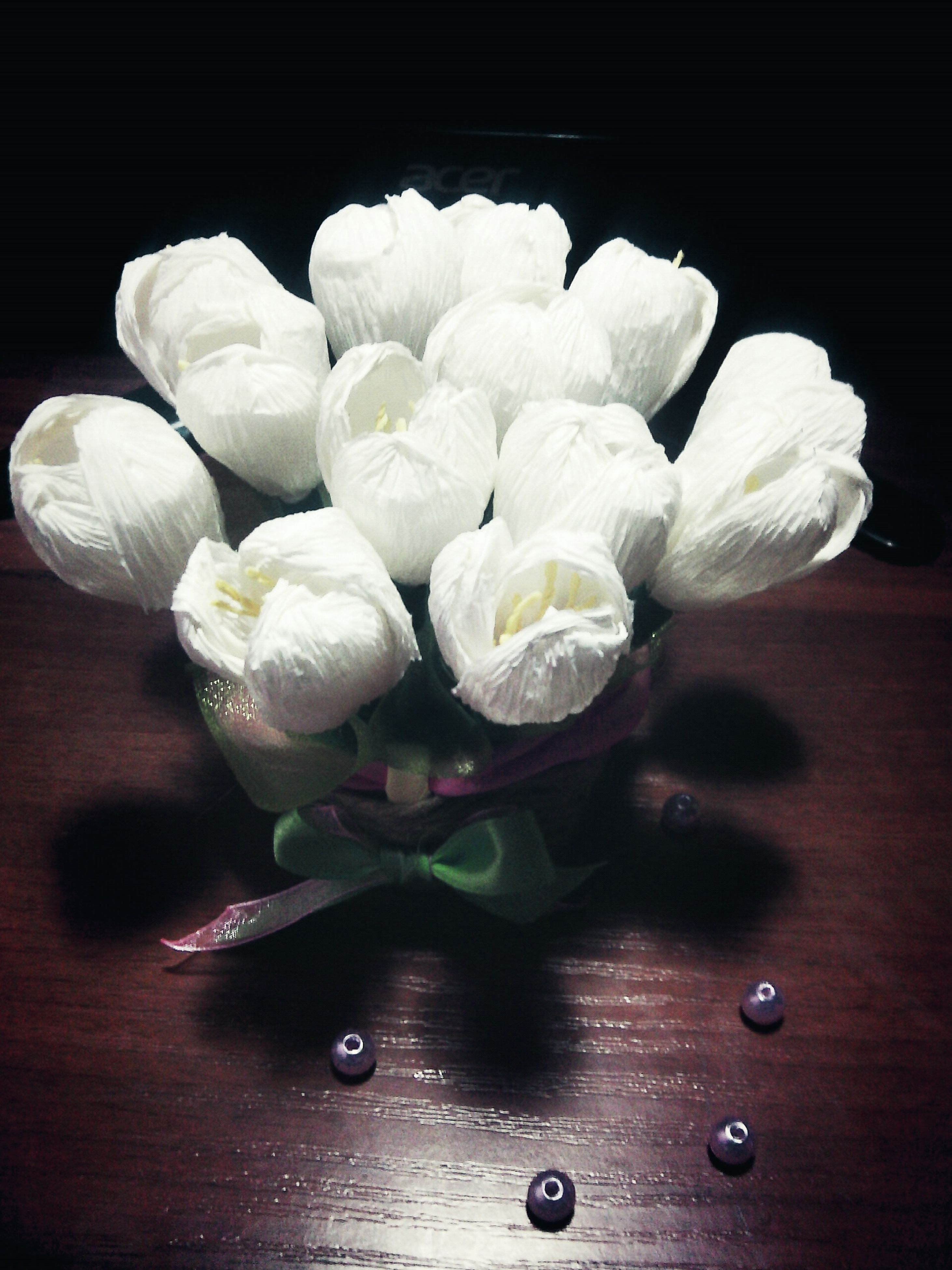 indoors, flower, freshness, table, fragility, close-up, still life, white color, black background, petal, high angle view, flower head, studio shot, wood - material, vase, no people, nature, directly above, beauty in nature, white