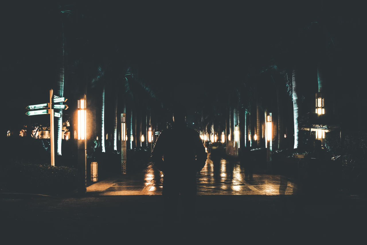 illuminated, rear view, night, the way forward, walking, one person, real people, full length, architecture, built structure, indoors, people