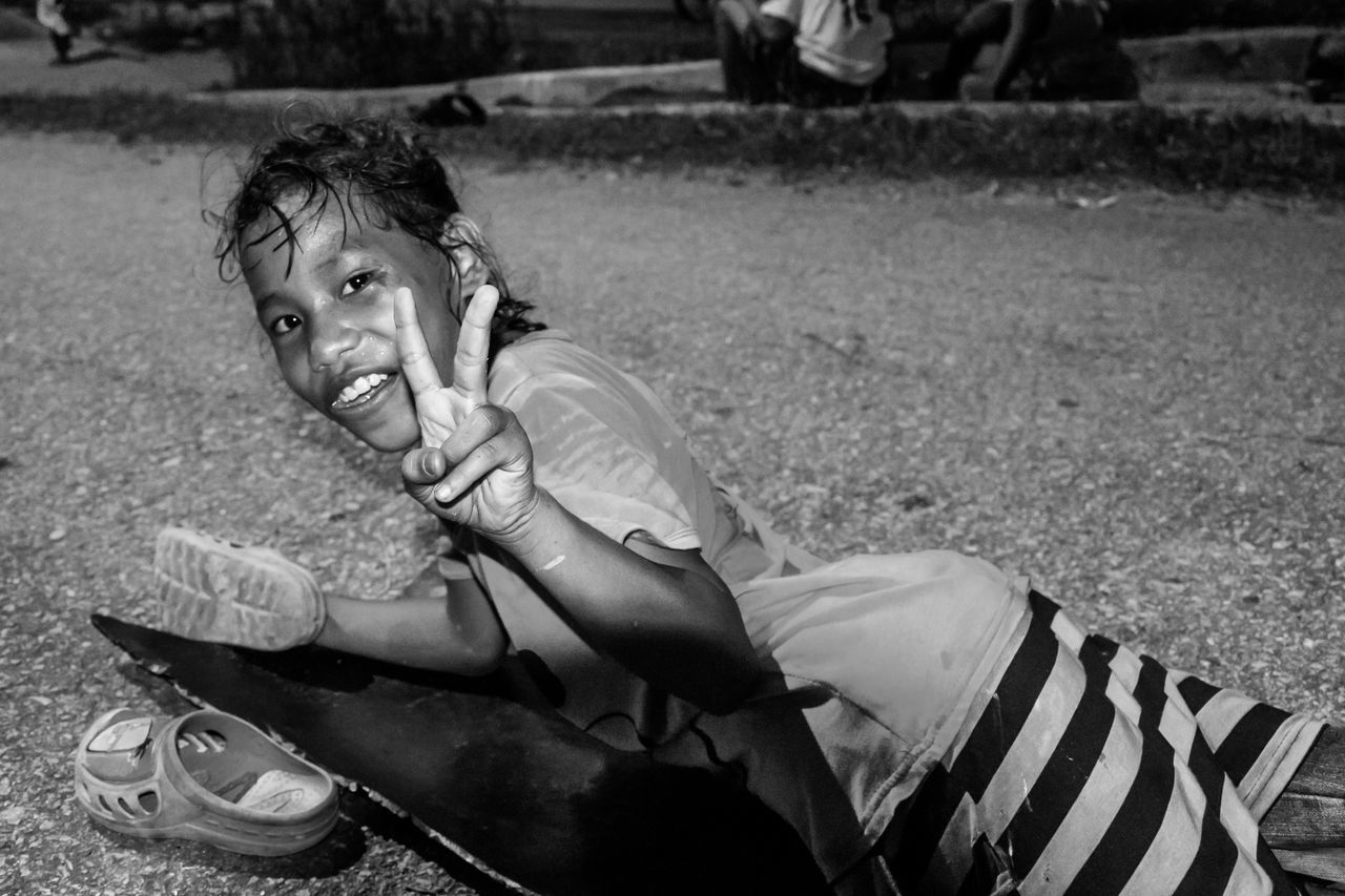Looking At Camera Innocence Children Leisure Activity Childhood Orang Asli Indigenous People Black And White People Streetphotography People Photography Street Photography Playing Outside Night Photography Capture The Moment Street Portrait People And Places
