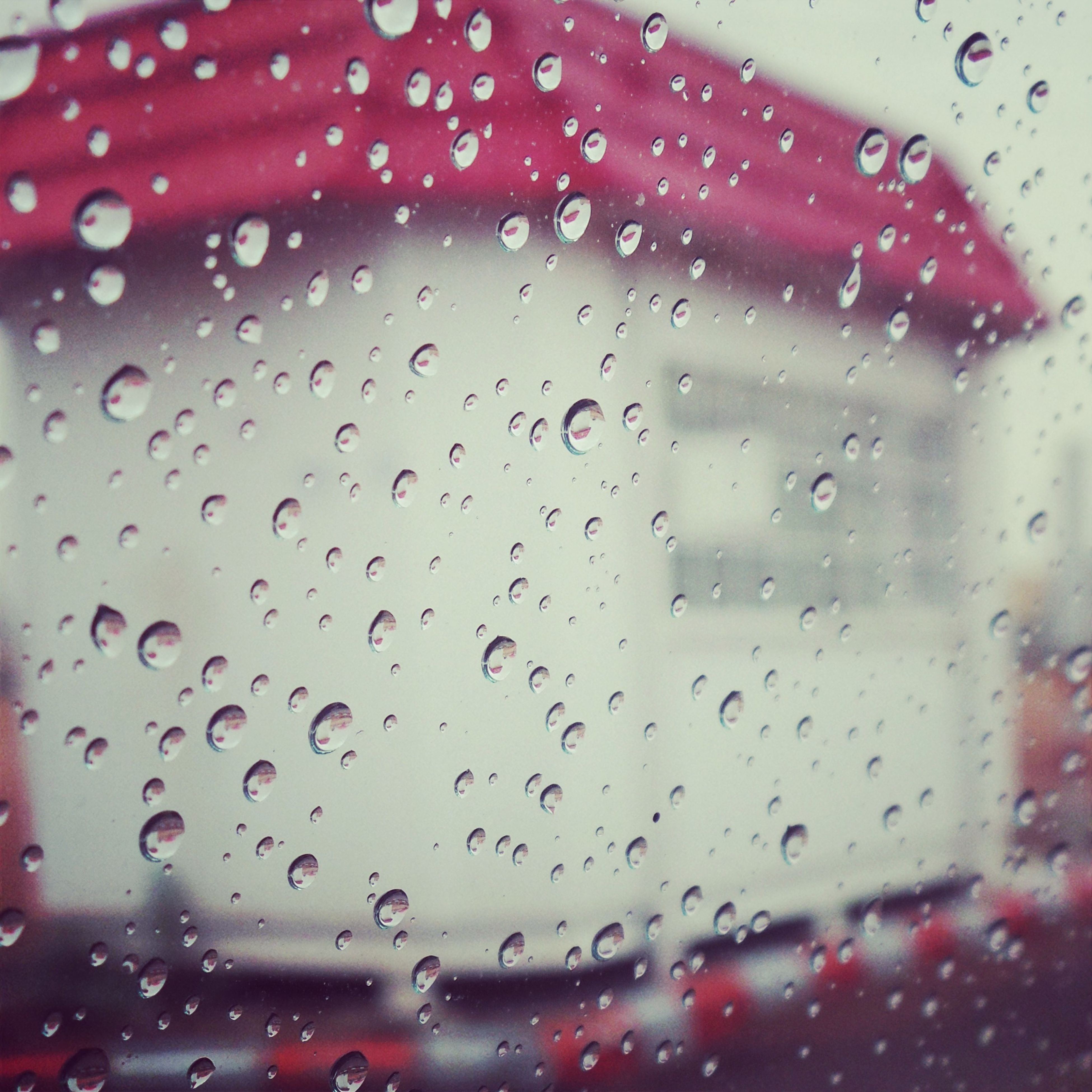 drop, wet, transparent, window, rain, glass - material, indoors, transportation, water, car, mode of transport, weather, vehicle interior, raindrop, close-up, backgrounds, red, full frame, season, land vehicle