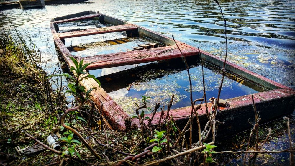 Boat on the river Damaged Obsolete Abandoned Run-down Old Deterioration Boat Water Nautical Vessel Lake Transportation Wood - Material Weathered Pier Broken Destruction Bad Condition Discard Mode Of Transport Tranquility River Old