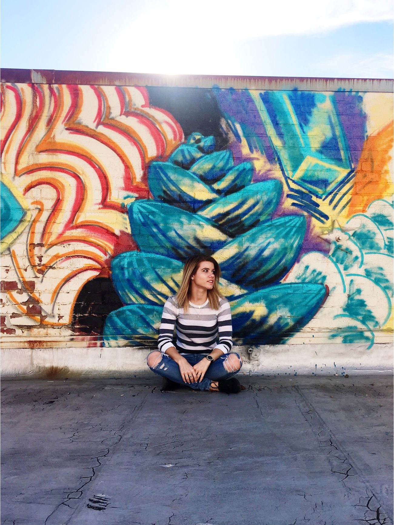 Full Length Casual Clothing One Person Multi Colored Cross-legged Sitting Beautiful Woman Front View Outdoors Young Adult Day Beauty Young Women Portrait People Urban Exploration Urbanphotography Urban City Real People Building Exterior Graffiti Art Graffiti Women Creativity