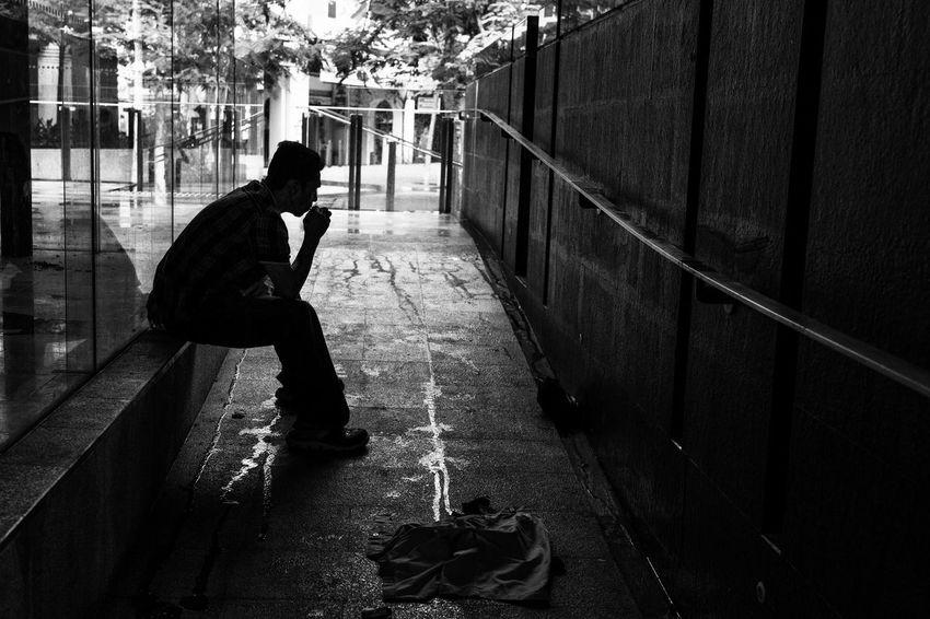 Sheltering from the rain. First Eyeem Photo smoking wet dark aloneness waiting sonys7rll streetphotograpghy streetmalaysia