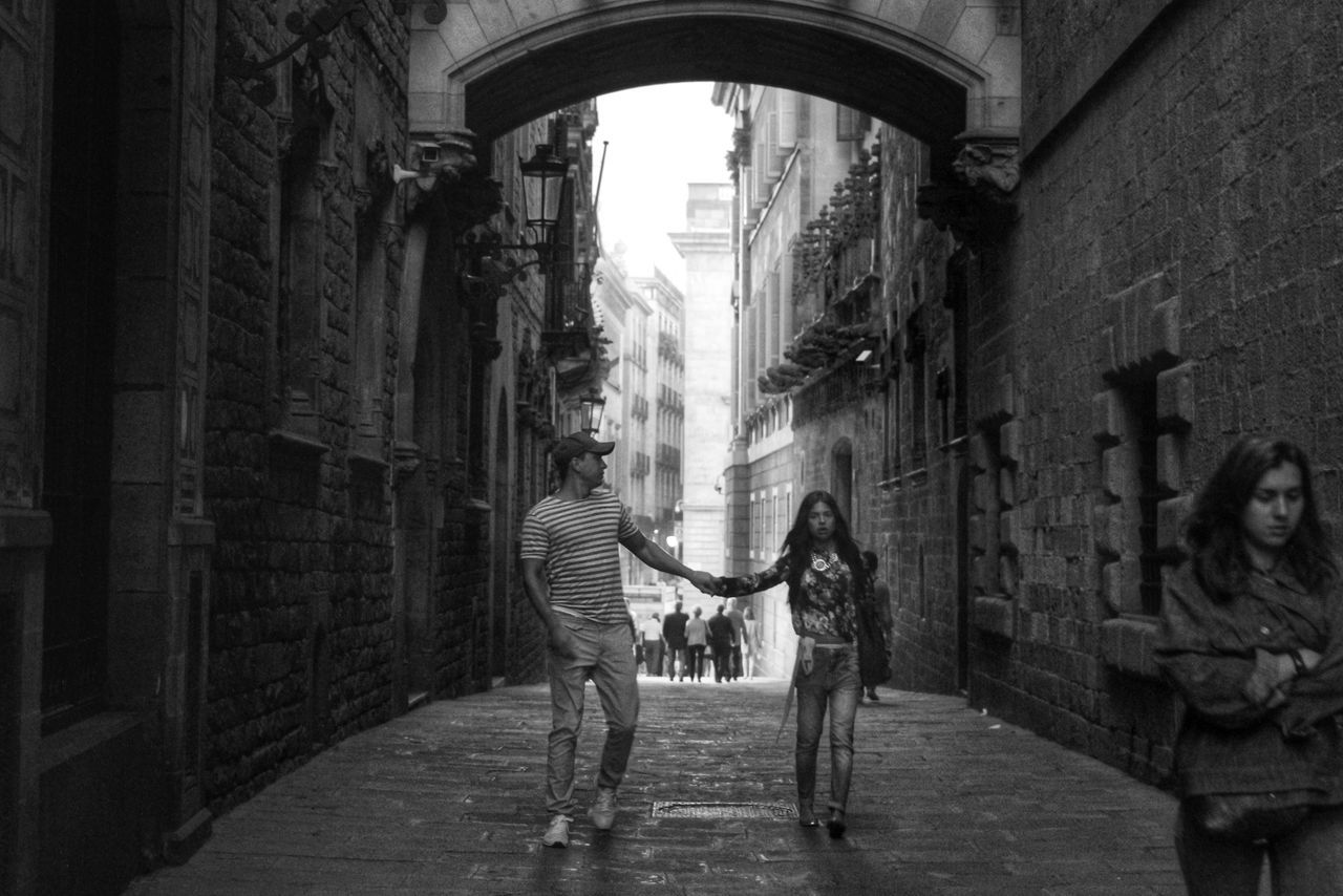 two people, togetherness, full length, built structure, architecture, love, young women, women, standing, happiness, city, young adult, day, real people, adult, building exterior, indoors, people, adults only, friendship