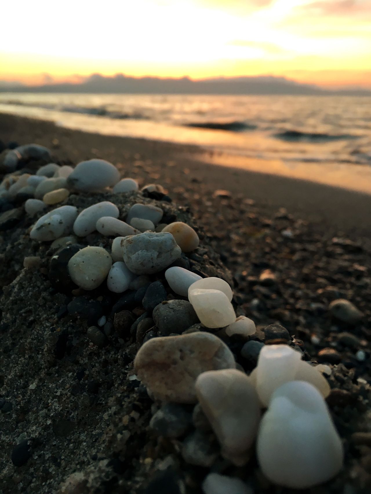 Live For The Story Greece Platanias Crete Sunset Sand Beach Sea Stones Focus On Foreground Cloudy Sunset #sun #clouds #skylovers #sky #nature #beautifulinnature #naturalbeauty #photography #landscape Shore Pebble Beach Water Outdoors Horizon Over Water Rock - Object Stone - Object Summer