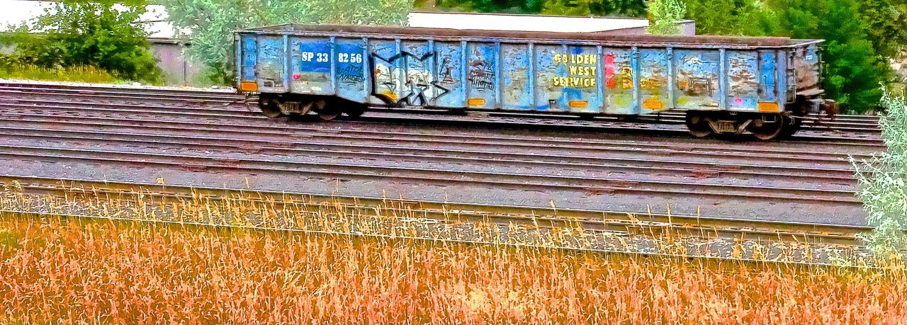 Colorado Colorado Photography Colorful Day Freight Train Freight Transportation Glenwood Springs Graffiti Graffiti Art Mode Of Transport No People Outdoors Rail Transportation The West Tracks Train Train Tracks Transportation