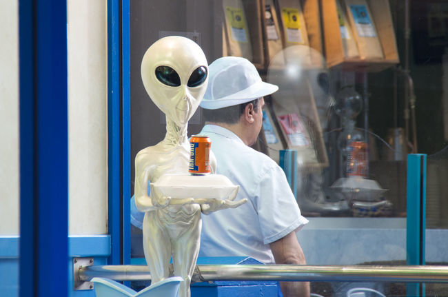 Chip shop near central station... I don't know why they picked an alien mascot. Alien Candid Central Station Chip Shop Day Fast Food Grey Hat Irn Bru People Portrait Reflection Scotland Scottish Shop Street The Shop Around The Corner Unrecognizable Person Window