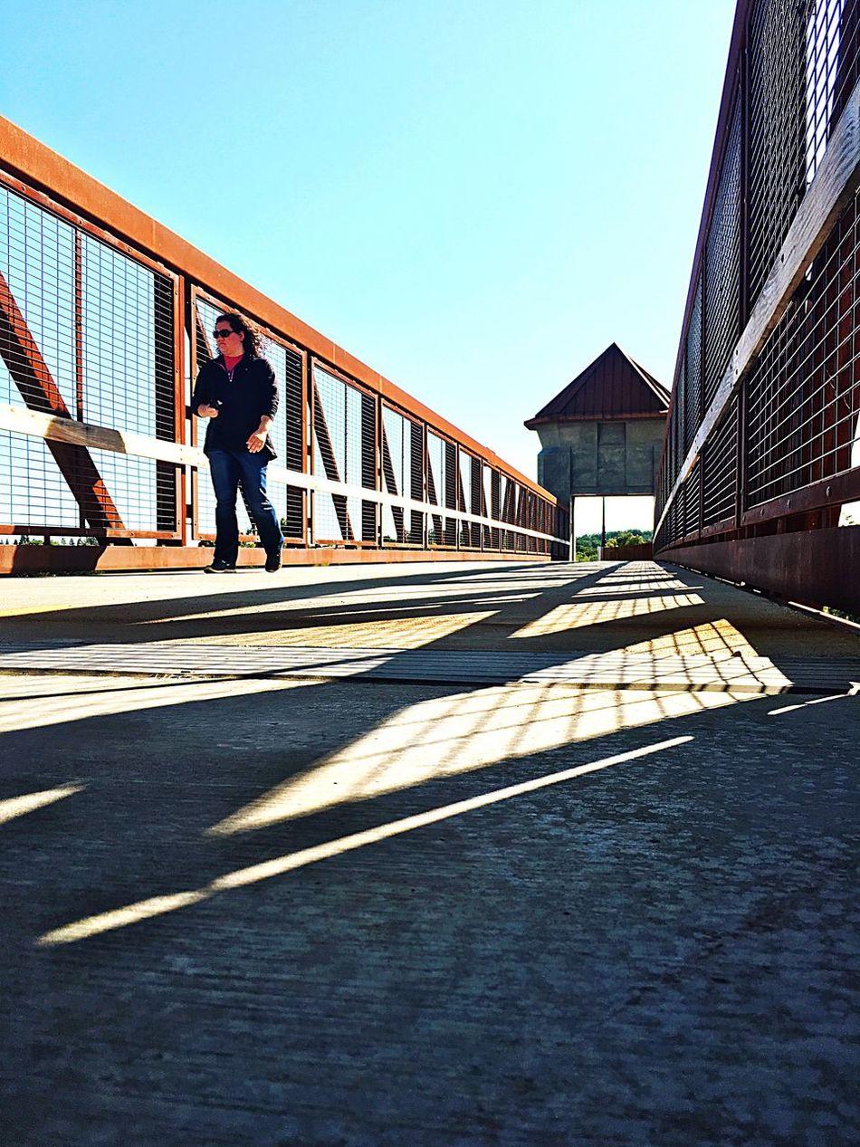 The Architect - 2016 EyeEm Awards Bridge - Man Made Structure Pedestrian Bridge Shadow Lines Woman Running On Bridge Metal Structure Johnny Cash Bridge