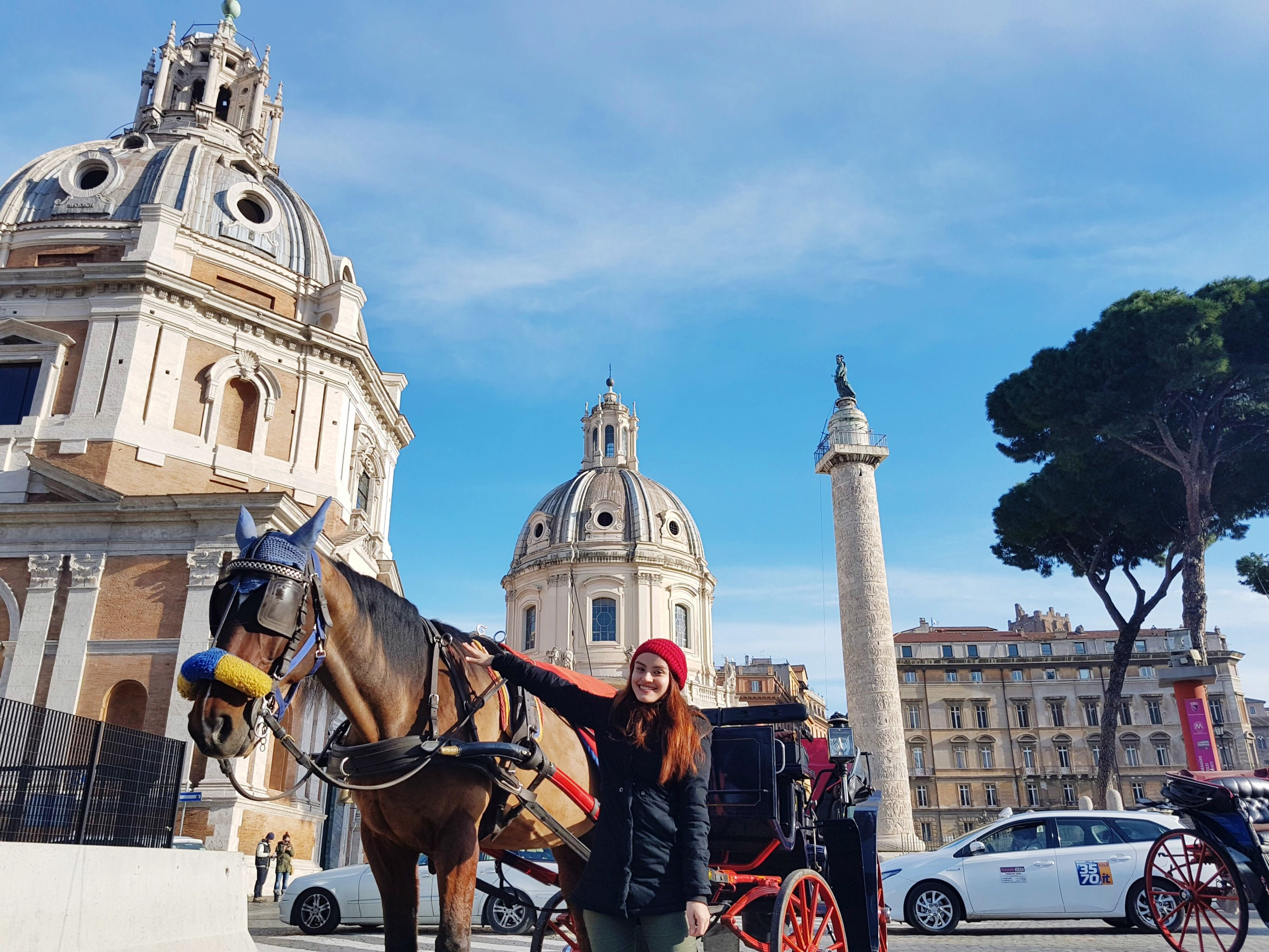 building exterior, animal themes, city, architecture, horse, transportation, travel destinations, domestic animals, working animal, built structure, outdoors, sky, adults only, horse cart, statue, carriage, day, people, adult