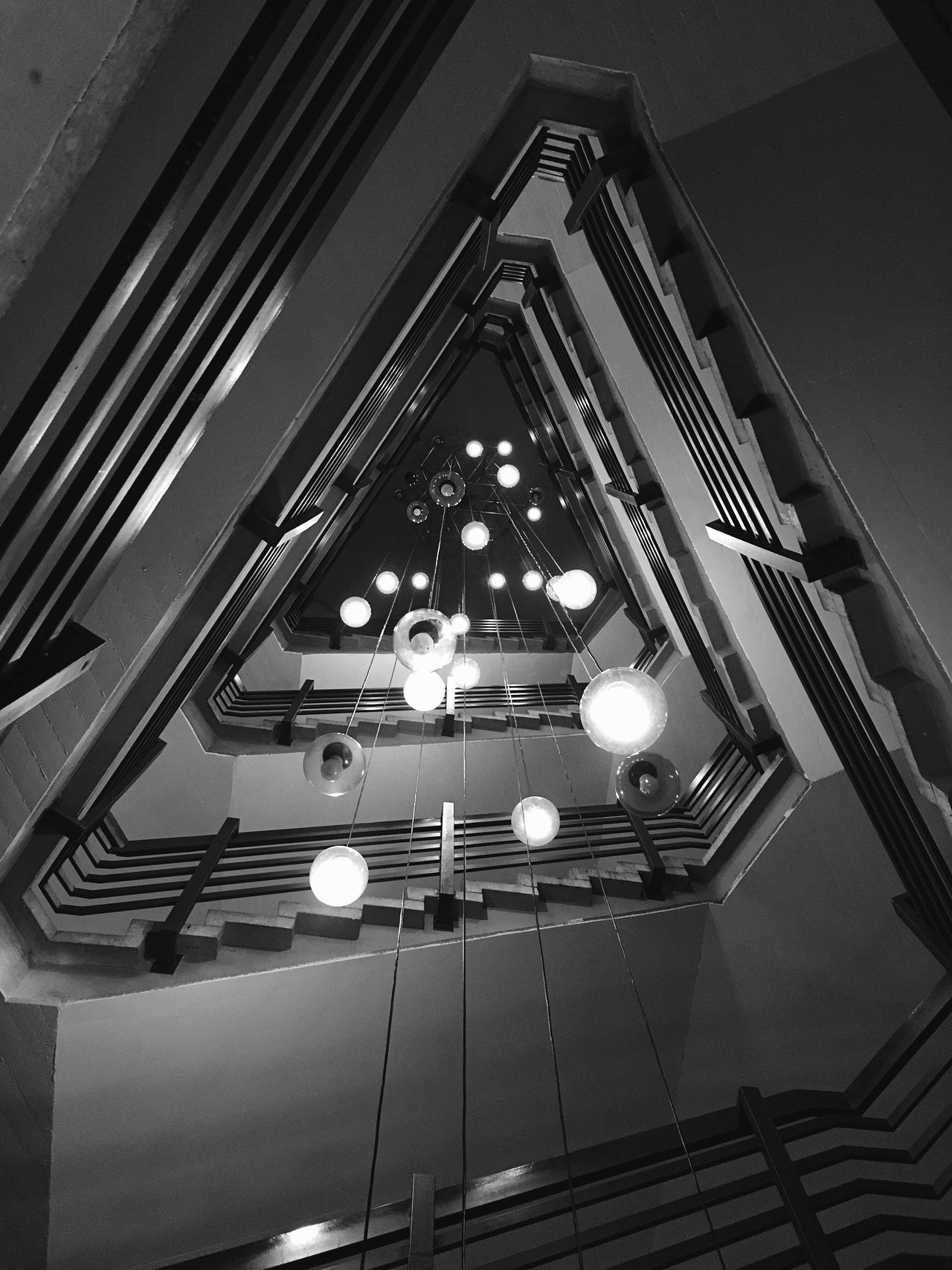 Low Angle View Architecture Built Structure Illuminated No People Indoors  Day Shadowplay Stairs Stairways Best Of Stairways Shadows & Lights Light And Shadow Black And White Blackandwhite Blackandwhite Photography Black & White The World Needs More Spiral Staircases Architectureporn Lighting Equipment Berliner Ansichten Staircase