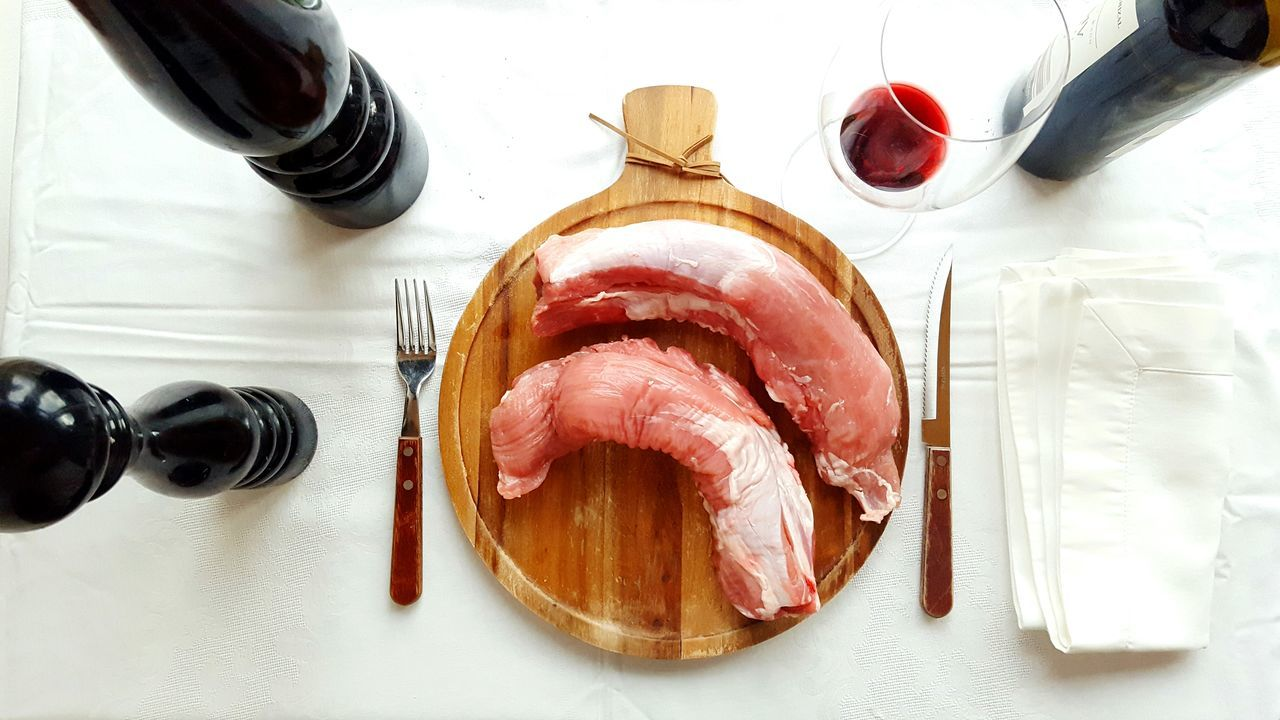High Angle View Indoors  Kitchen Food And Drink Preparing Food Lunch Food No People Table Still Life Meat! Meat! Meat! Meat Pork Meat Pork Wine Wineglass Red Wine Cutlery Wooden Plate Salt And Pepper High Contrast White Background Lifestyles Eating