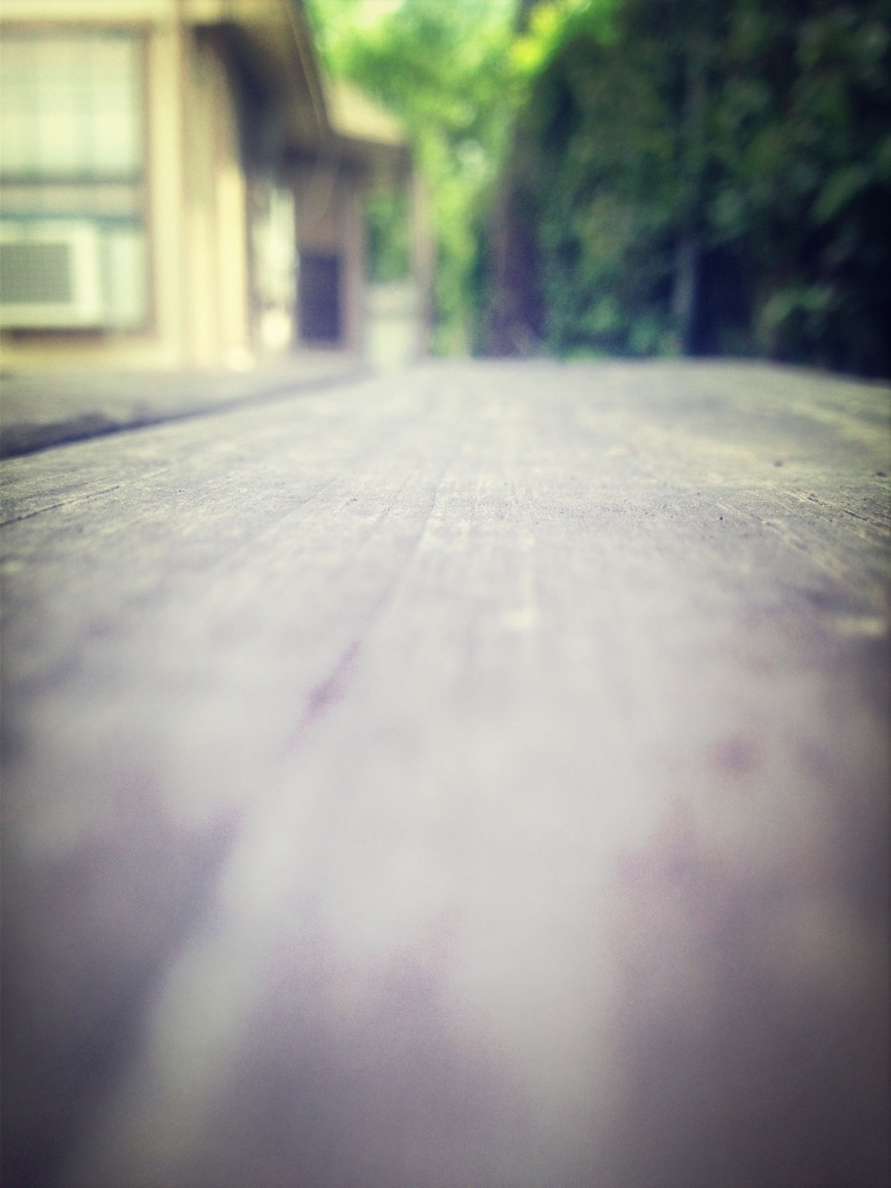 selective focus, surface level, focus on foreground, close-up, built structure, architecture, day, the way forward, no people, sunlight, outdoors, building exterior, empty, shadow, nature, street, diminishing perspective, footpath, wood - material, textured