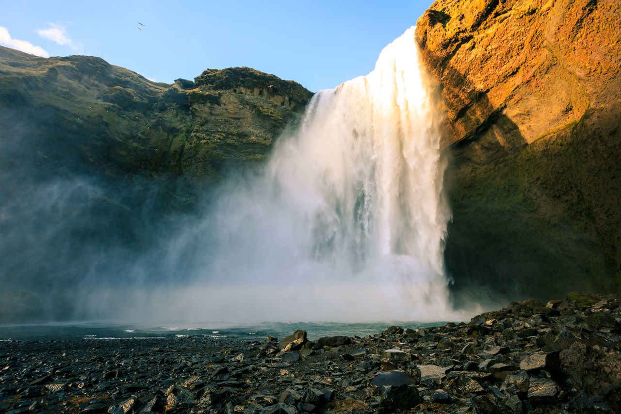 Beauty In Nature Clear Sky Day Iceland Idyllic Long Exposure Motion Mountain Nature No People Outdoors Physical Geography Power In Nature Rock - Object Rock Formation Scenics Sea Skogafoss Skogafoss Falls, Iceland Sky Tranquil Scene Tranquility Travel Destinations Water Waterfall