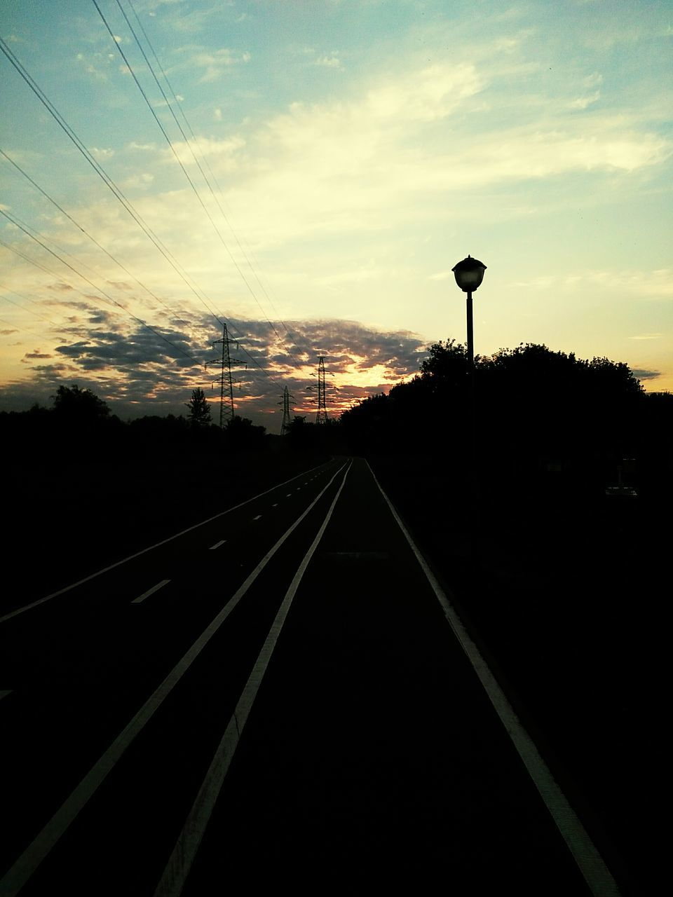 transportation, railroad track, silhouette, rail transportation, sunset, diminishing perspective, no people, sky, the way forward, cable, cloud - sky, straight, nature, outdoors, day, electricity pylon