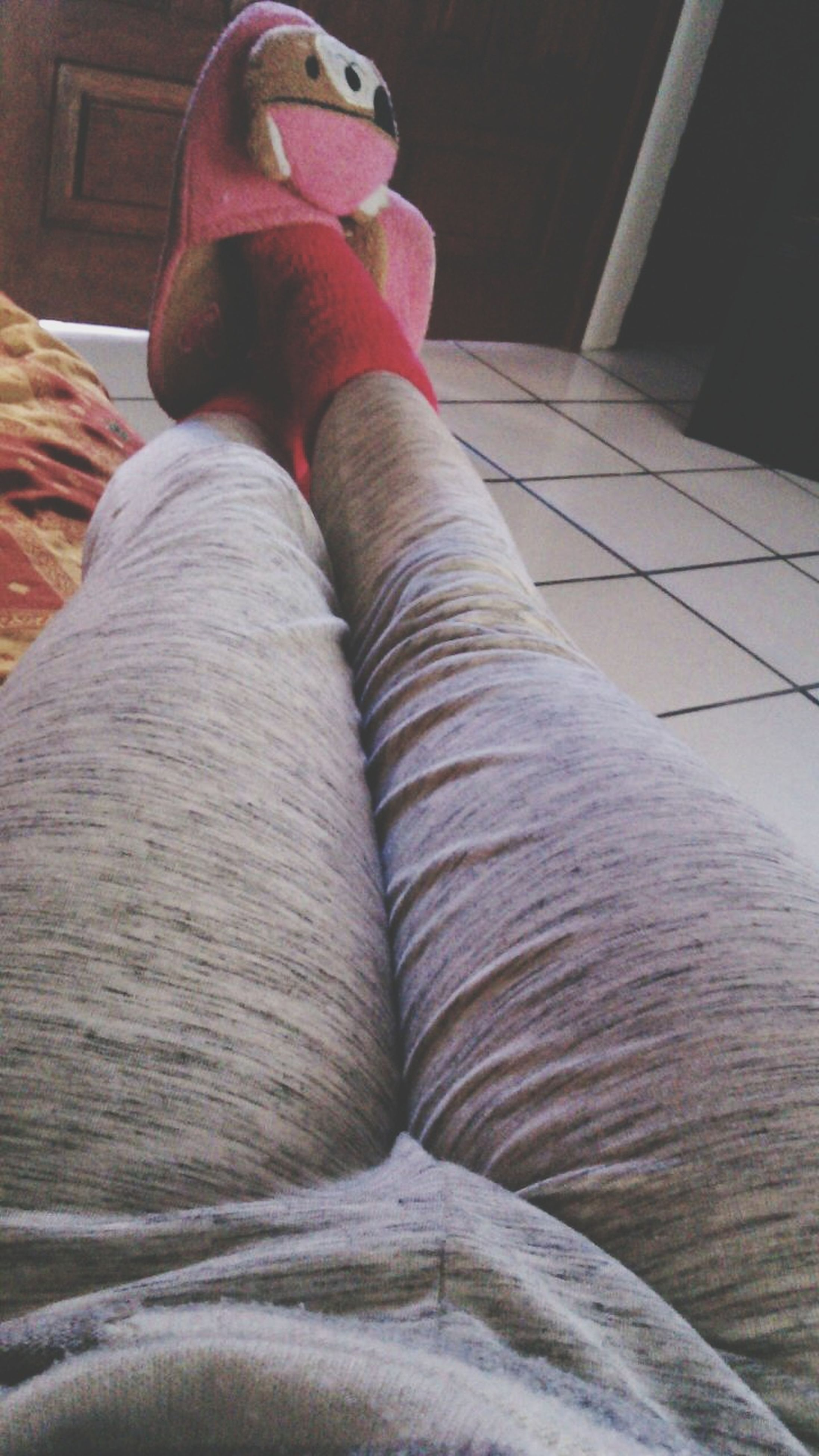 indoors, low section, person, relaxation, bed, human foot, sitting, lifestyles, home interior, part of, barefoot, close-up, jeans, shoe, personal perspective, textile