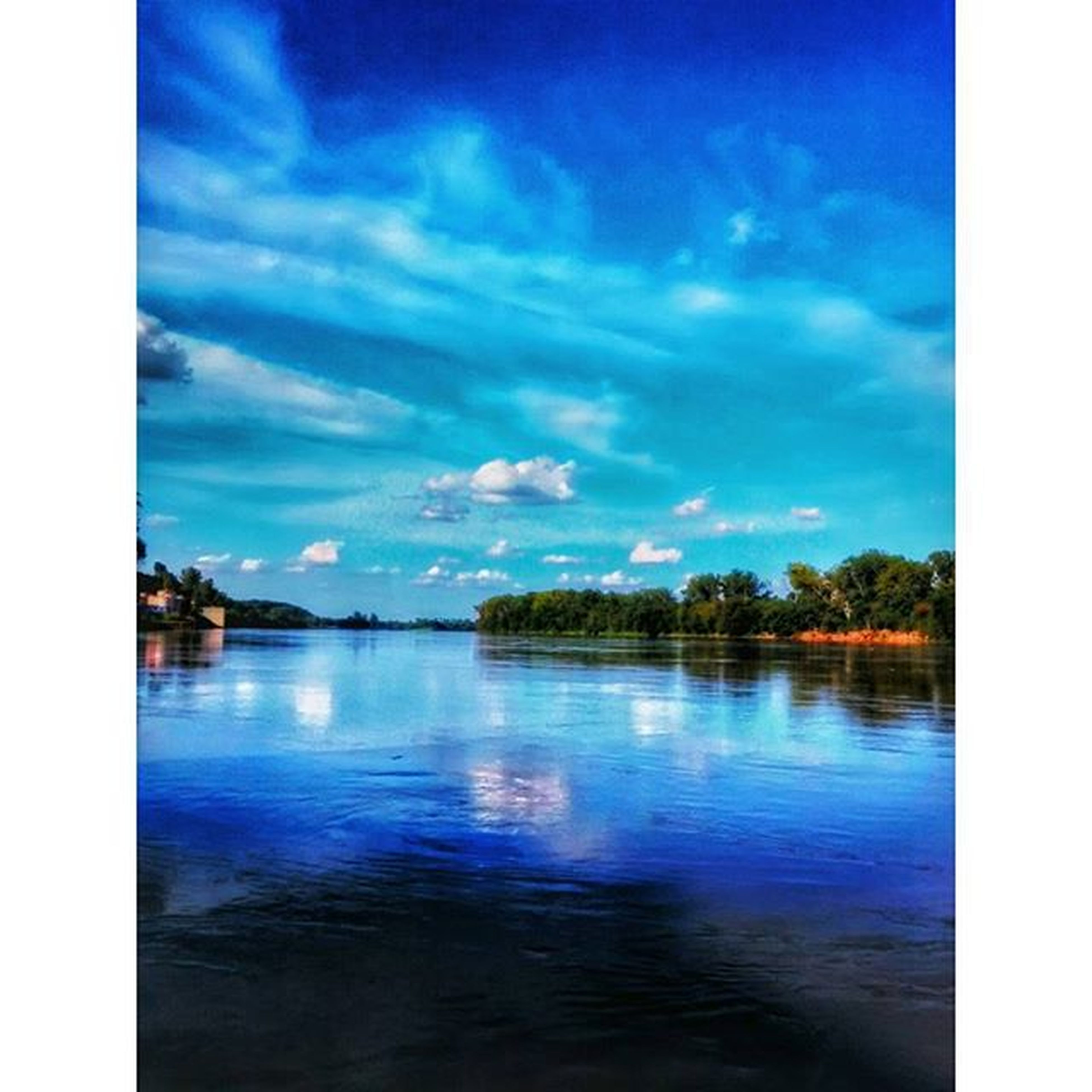 transfer print, water, auto post production filter, sky, tranquil scene, scenics, reflection, tranquility, blue, beauty in nature, lake, waterfront, cloud - sky, cloud, nature, idyllic, tree, panoramic, calm, outdoors