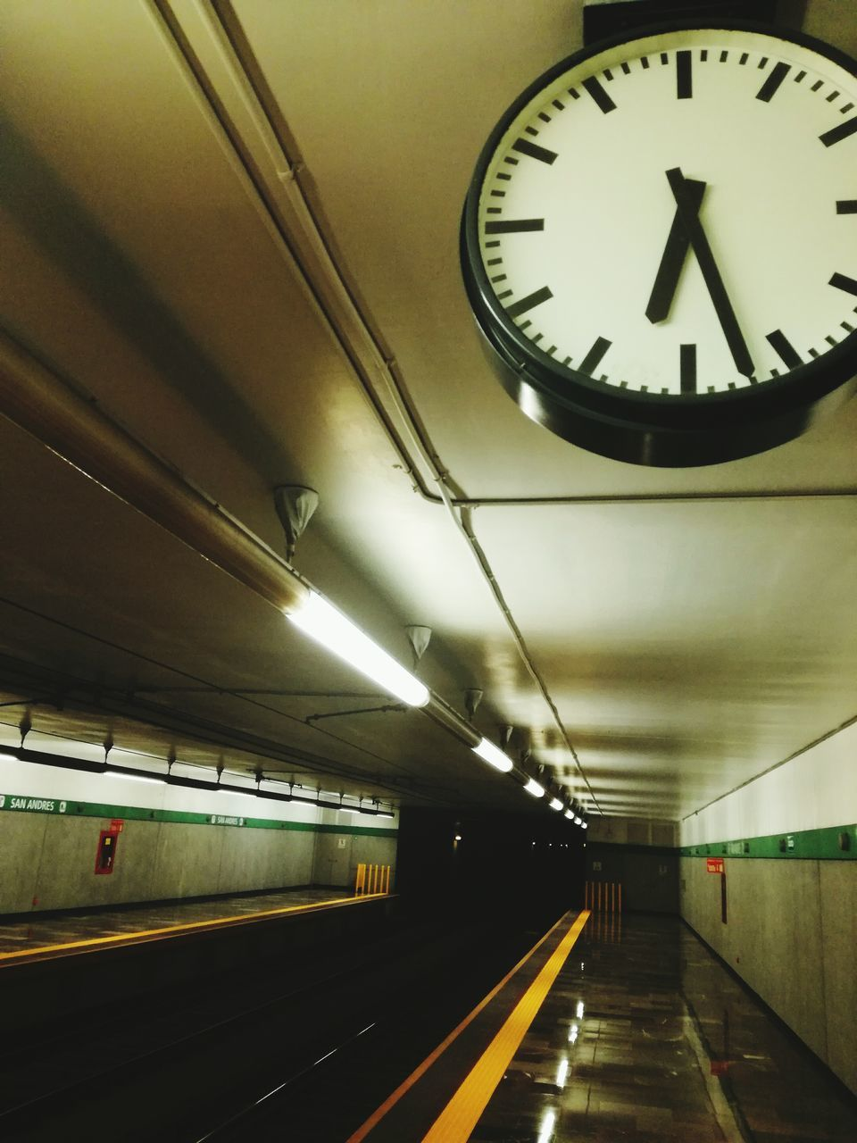 illuminated, transportation, indoors, subway station, public transportation, rail transportation, clock, ceiling, time, built structure, subway train, no people, clock face, day
