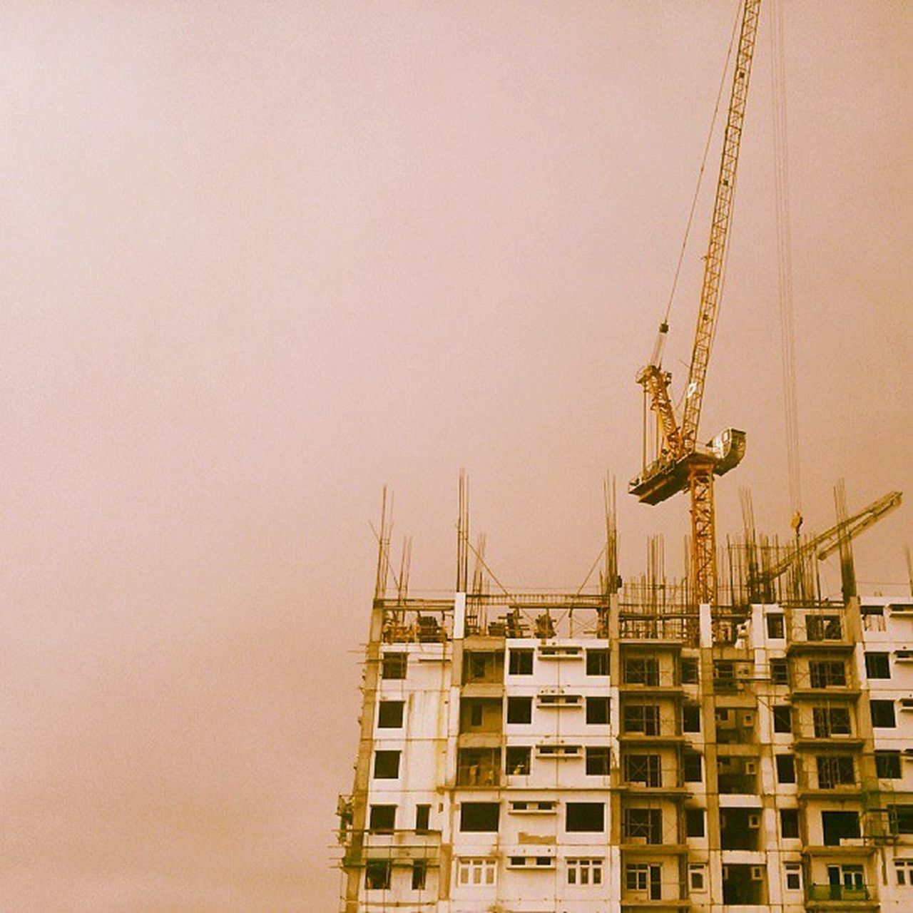 architecture, construction site, development, construction, built structure, crane - construction machinery, building exterior, copy space, building - activity, crane, progress, no people, construction machinery, industry, city, low angle view, clear sky, outdoors, sky, cityscape, day
