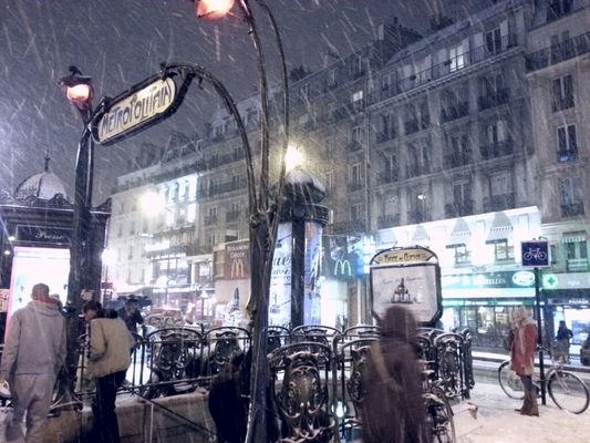 snowing at Place de Clichy by Mika
