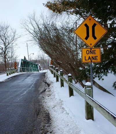 narrow bridge Winter Snow Cold Temperature Road Sign Warning Sign Communication Outdoors Road Tree Day No People Nature Sky