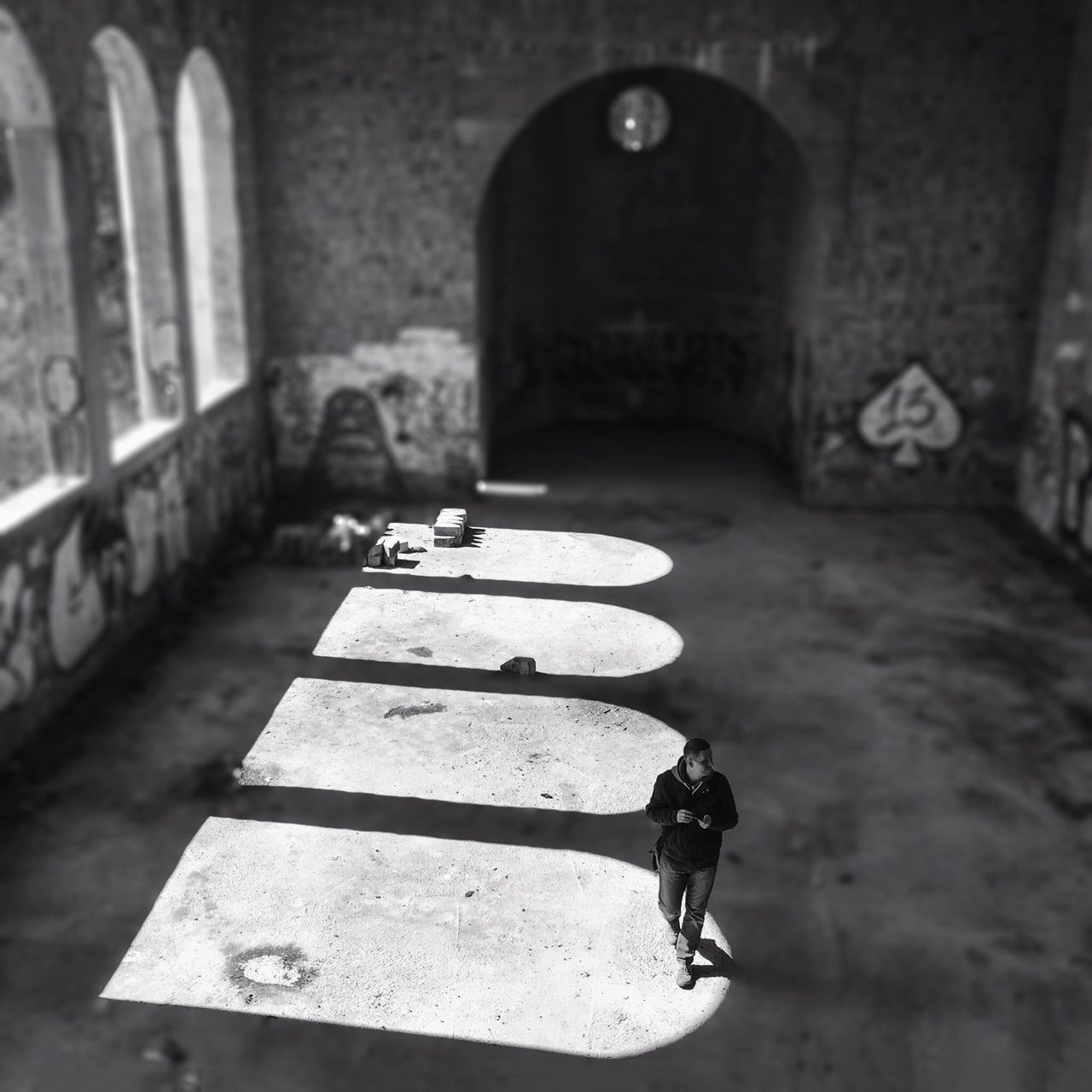 High Angle View Of Man Walking In Abandoned Building