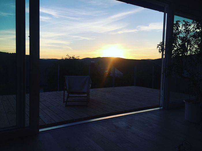 Schwarzwald Hochschwarzwald Titiseeneustadt View Sunset Window Indoors  Cloud Sun Sky Architecture Built Structure Transparent Home Interior Dark Building Exterior Pole Scenics Orange Color Cloud - Sky Glass Sunbeam Tranquil Scene Nature