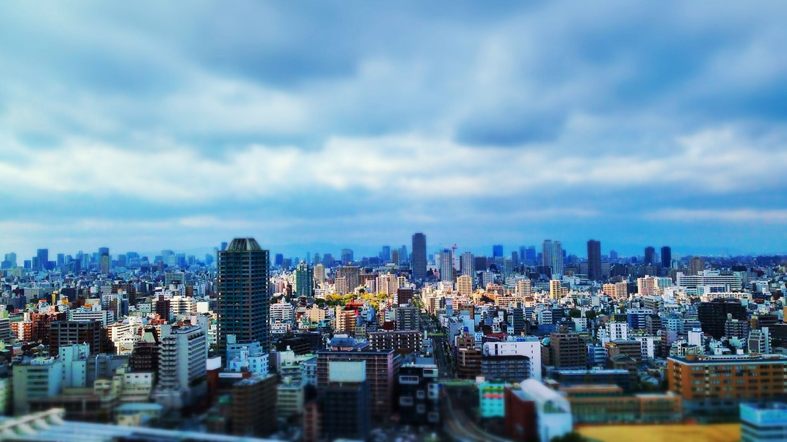 cityscape, building exterior, city, architecture, built structure, sky, crowded, skyscraper, cloud - sky, modern, residential district, residential building, cloudy, tower, cloud, tall - high, office building, high angle view, urban skyline, residential structure