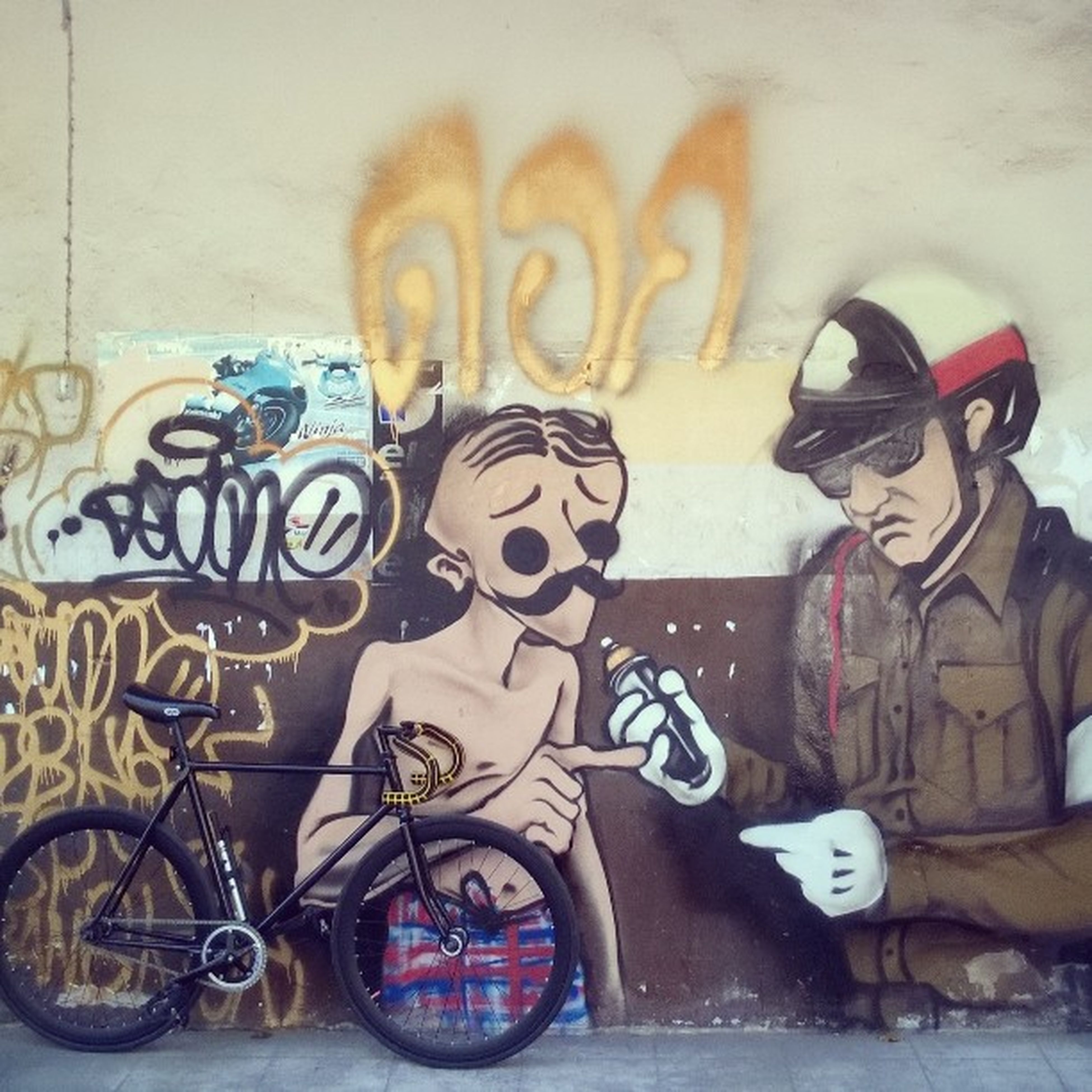 graffiti, art, art and craft, creativity, wall - building feature, human representation, street art, multi colored, bicycle, text, animal representation, wall, day, indoors, no people, transportation, western script, craft