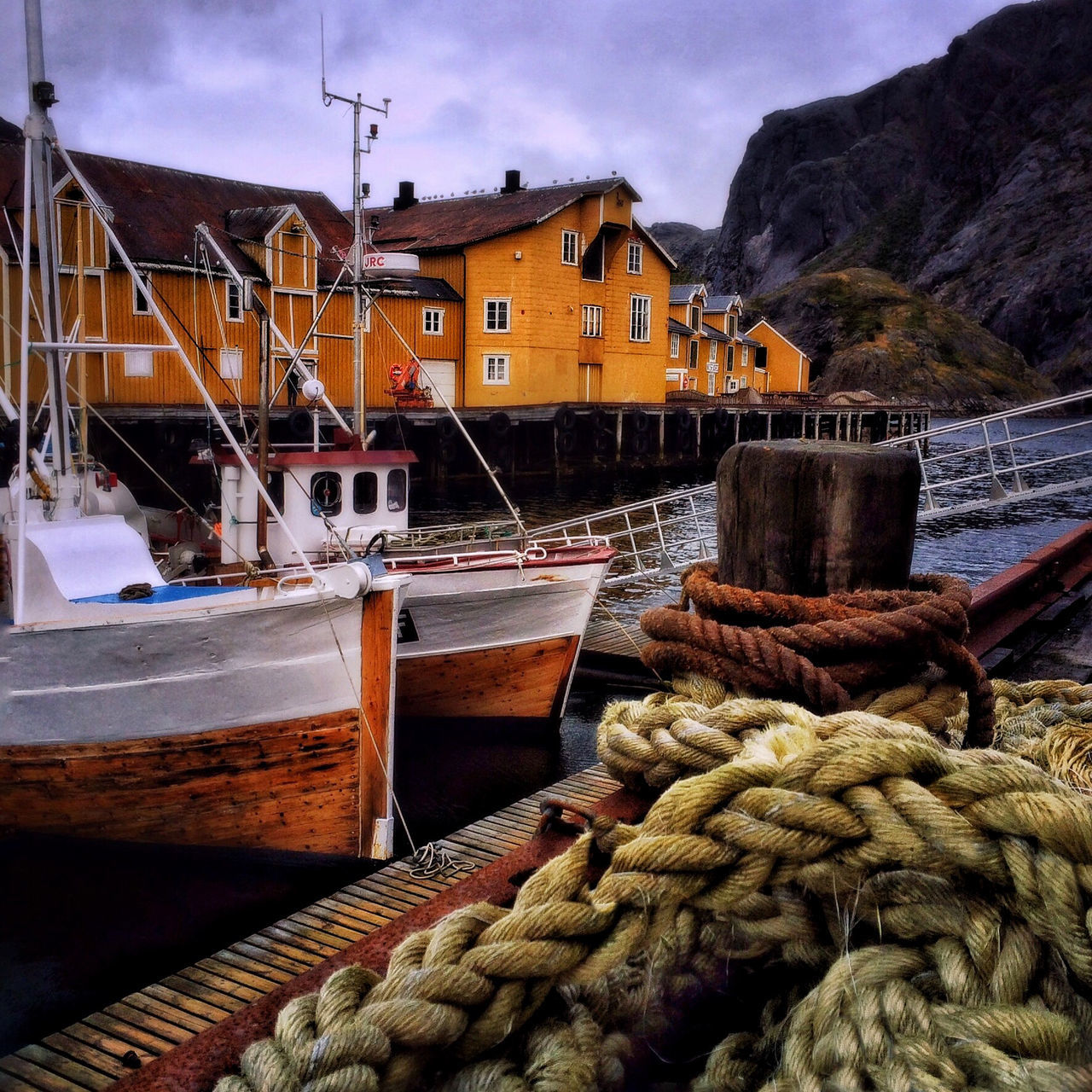 Beautiful fishing village of Nussfjord in Northern Norway. Boat Fishing Village Lofoten Islands Lofoten Norway Moored Fine Art Photography Norway Nussfjord Perspective Rope Traditional Fishing Boat Travel Fine Art Finding New Frontiers