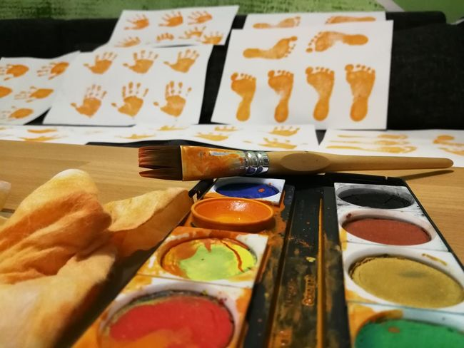 Hand and foot-print's of a child Colorful Art Hand Print Hand Prints Footprints FootPrint Watercolor Childhood Orange Color Table Indoors  Human Body Part Food Close-up Palette One Person