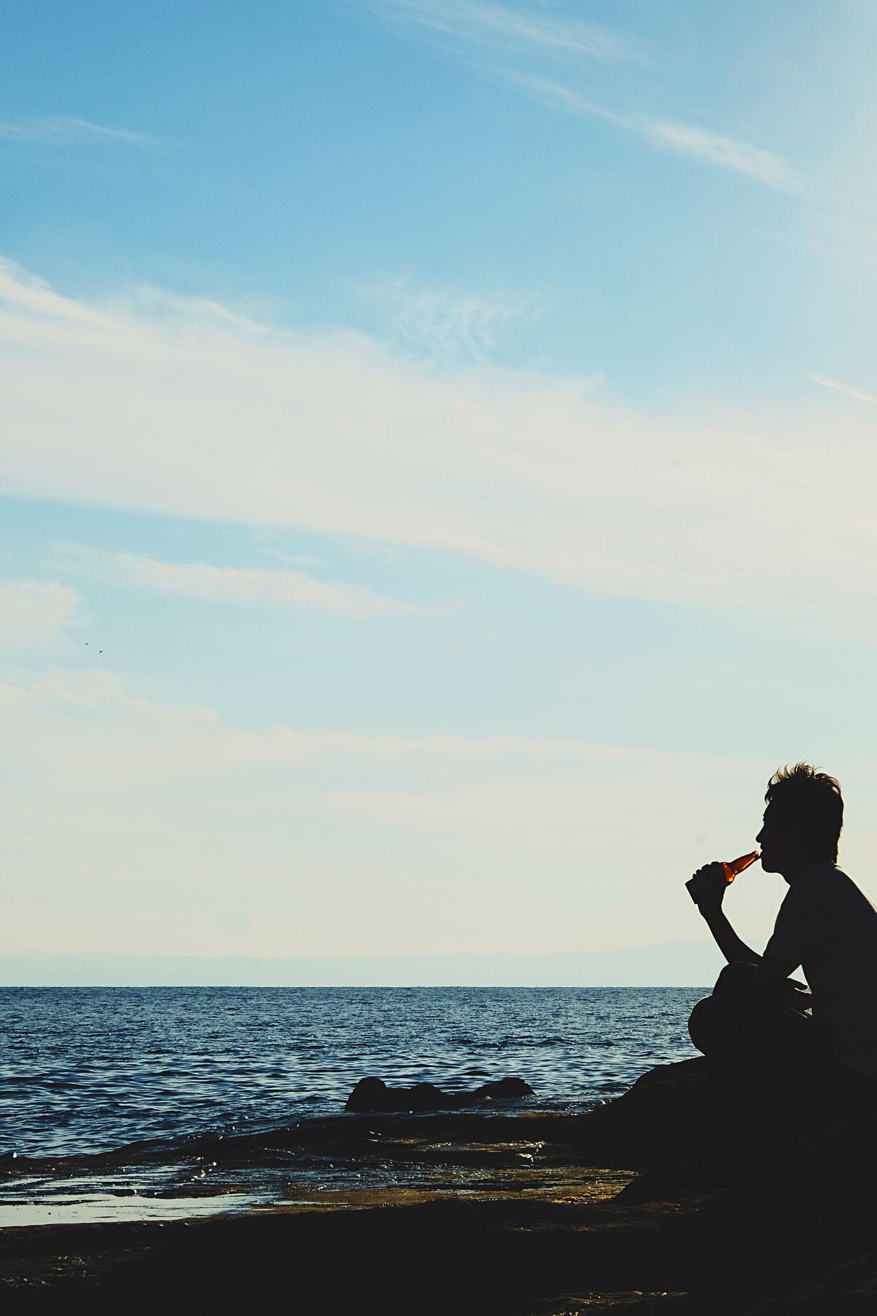 Enjoy solitude Sea Horizon Over Water Sky Lifestyles Enjoying Life Enjoying The Sun Enjoying The View Enjoy Enjoyment Scenics Beauty In Nature Water Beach Cloud - Sky Ocean Oceanside Drinks Drink Drinking Beverage Silhouette Silhouette_collection Beer Beer Time