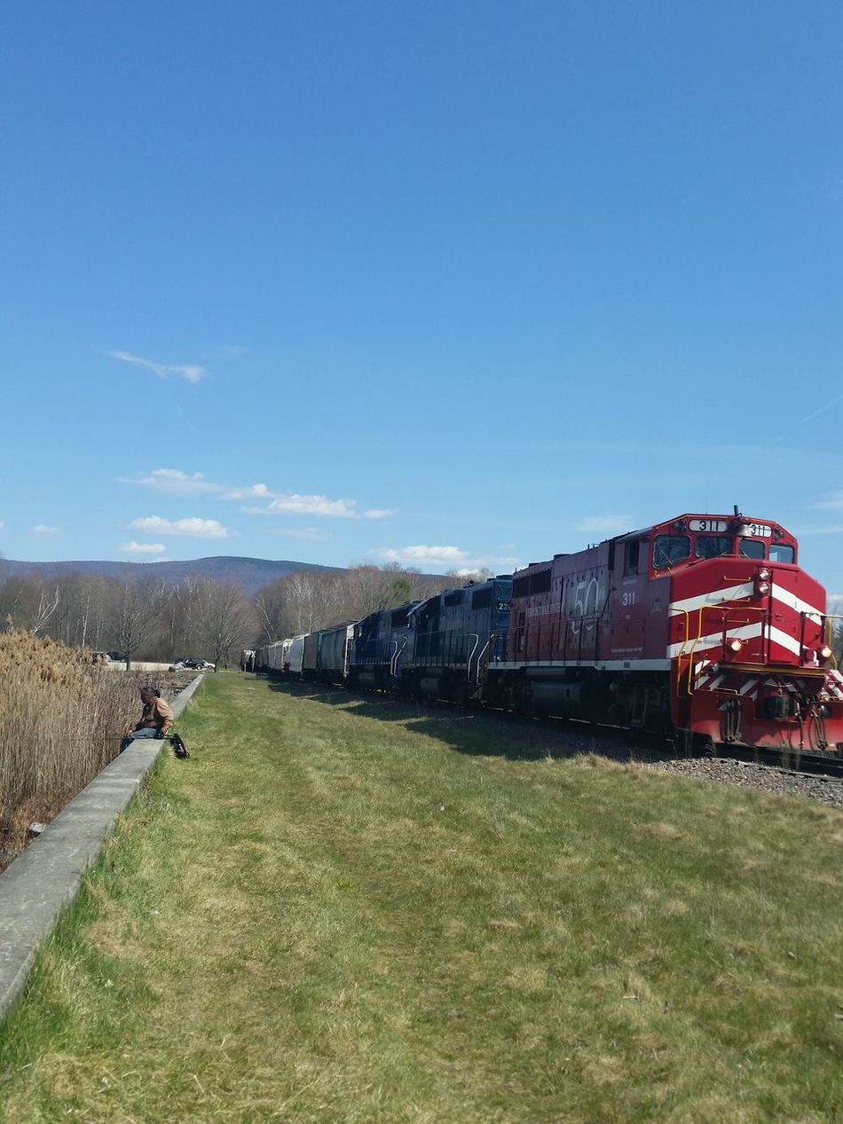 Four Train Engines Train Engine Plate Train Number Train Number 311 Red Engine Pushing Containers Cars Choo Choo Train ALL ABOARD! Clear Blue Sky Trees Negative Space Green Mountain State Early Spring Fishing Open Edit