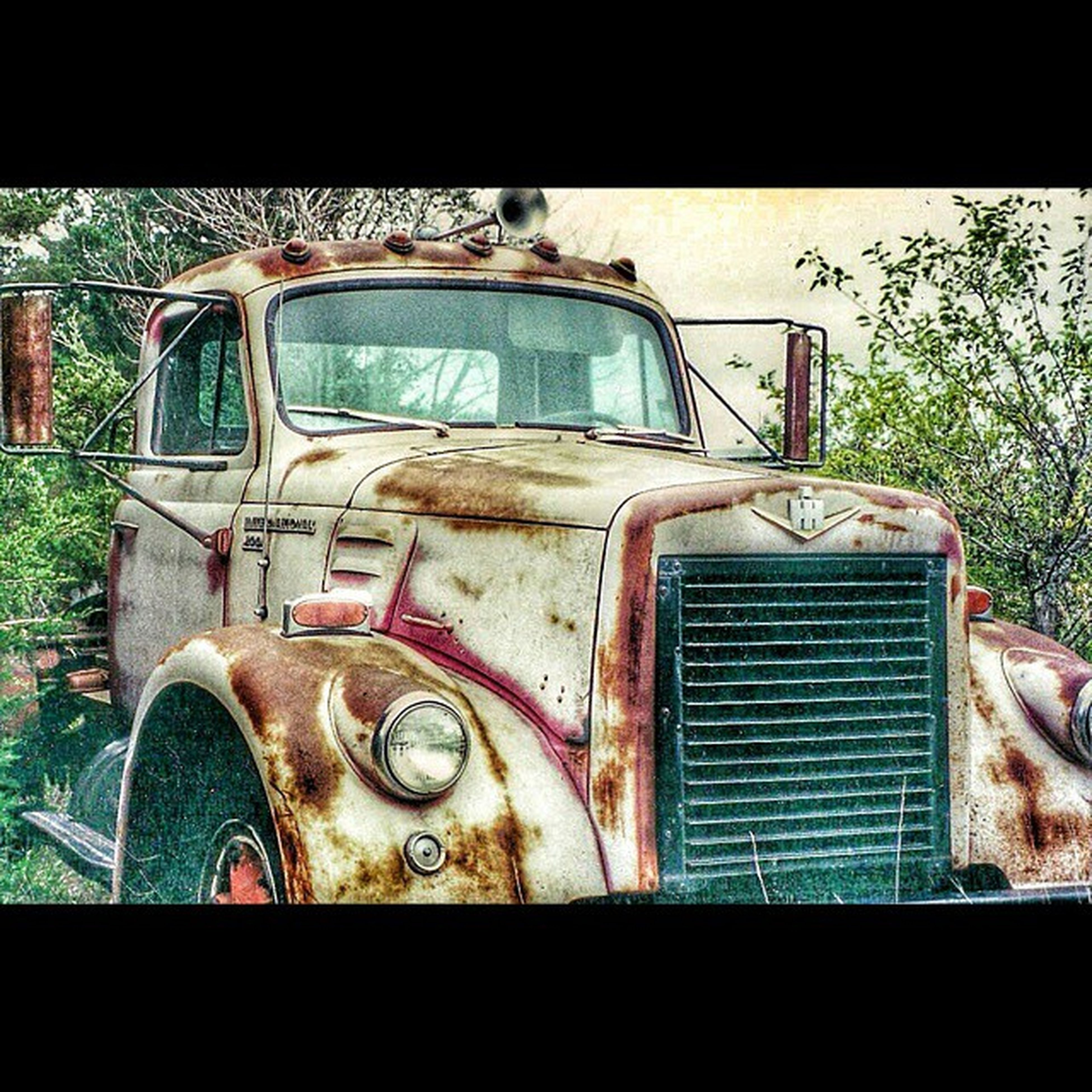 transfer print, land vehicle, auto post production filter, abandoned, obsolete, mode of transport, old, car, transportation, old-fashioned, building exterior, damaged, retro styled, built structure, window, run-down, deterioration, sky, day, outdoors