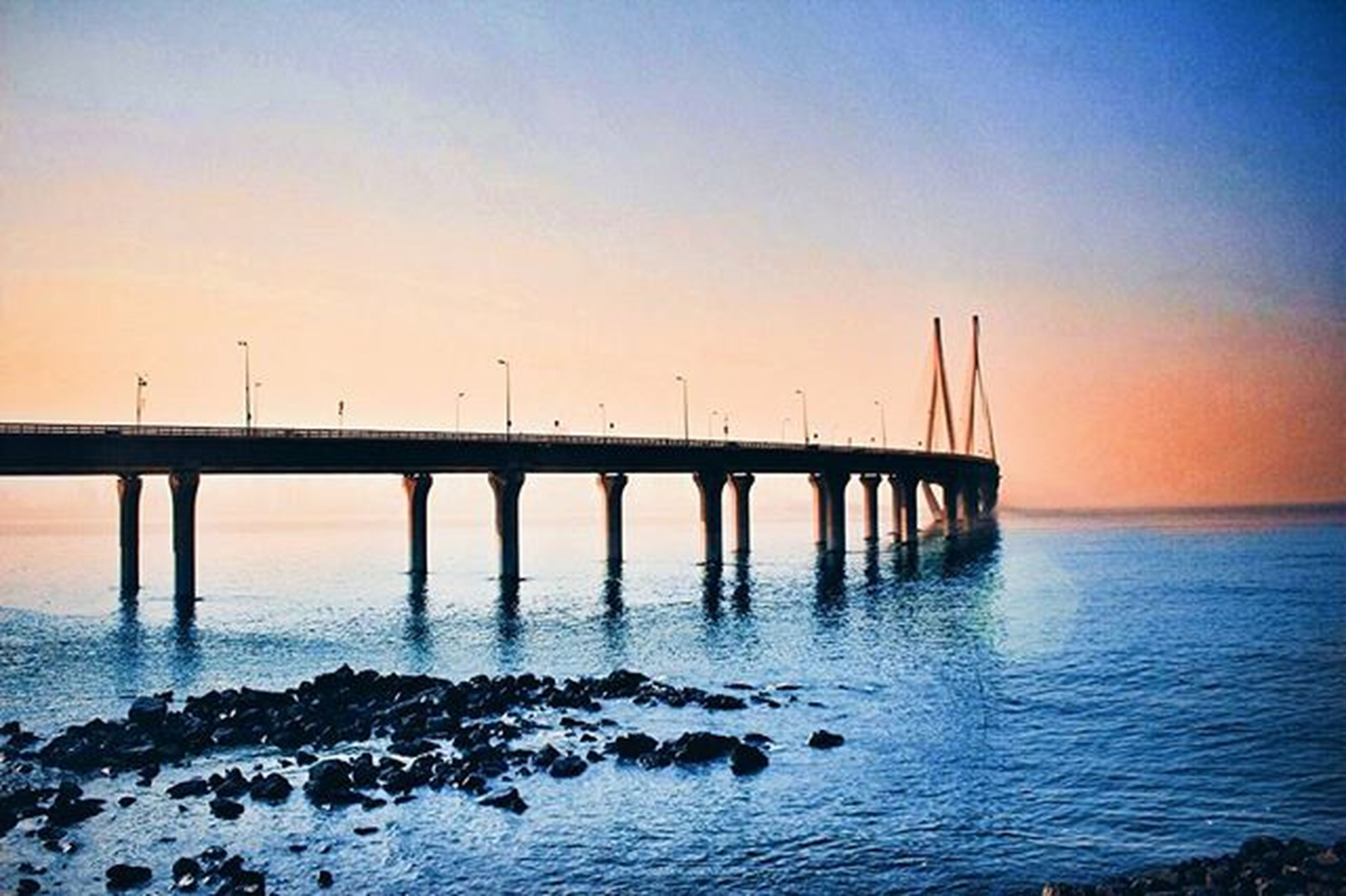 water, sea, sunset, connection, built structure, clear sky, pier, bridge - man made structure, tranquil scene, tranquility, copy space, scenics, nature, bird, beauty in nature, architecture, bridge, horizon over water, sky, idyllic