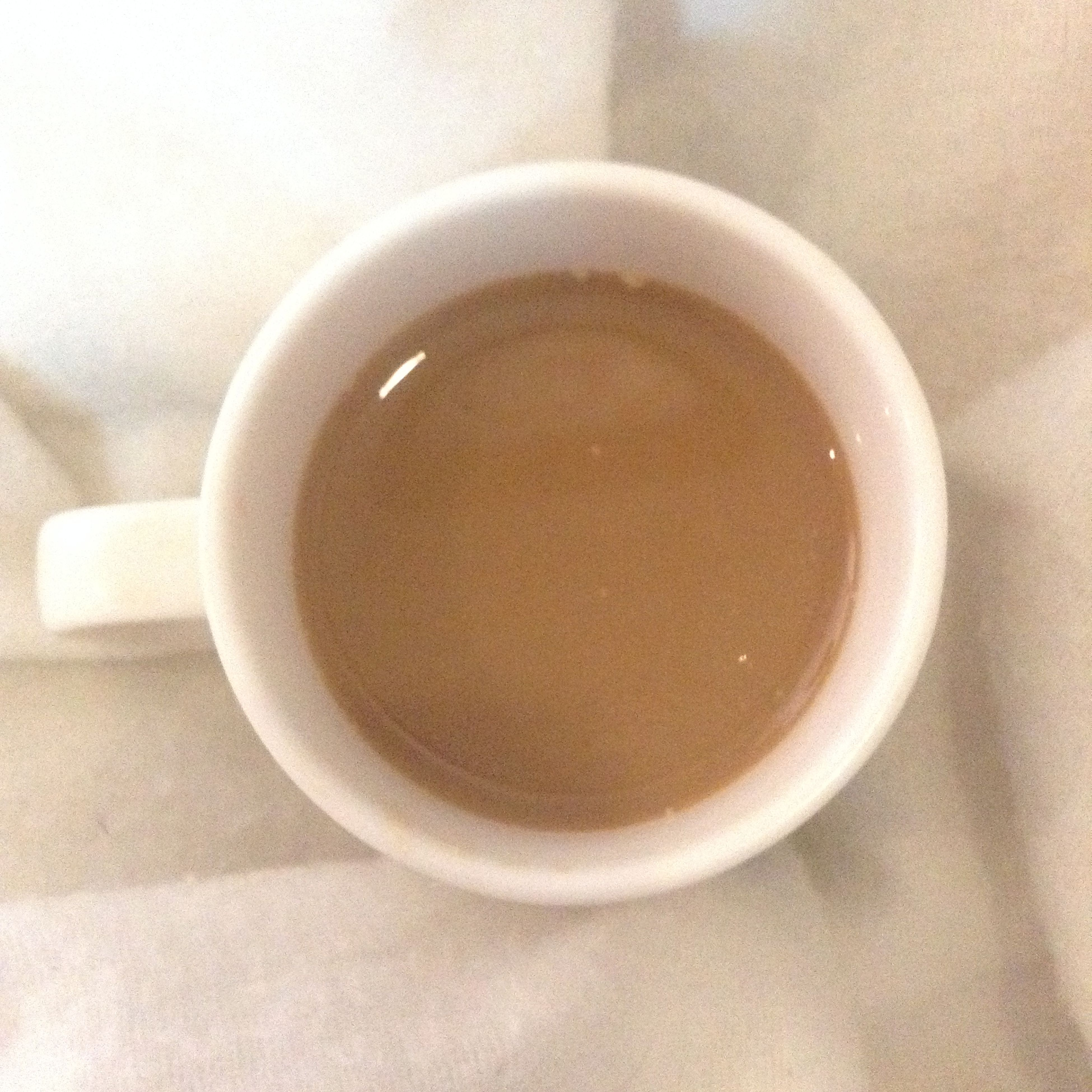 indoors, coffee cup, food and drink, drink, still life, refreshment, table, high angle view, coffee - drink, saucer, cup, directly above, close-up, freshness, coffee, spoon, no people, overhead view, tea cup, circle