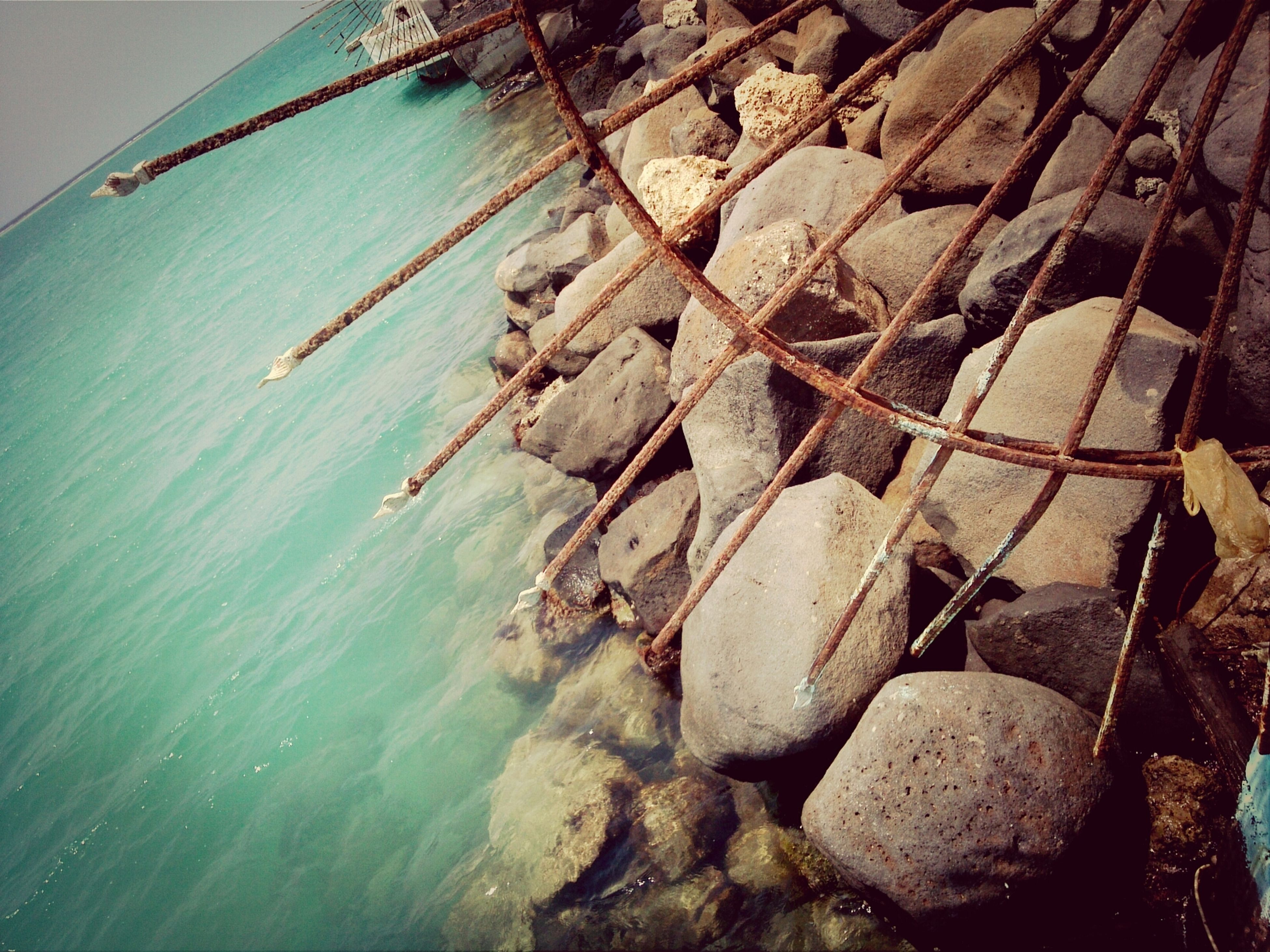 water, sea, rock - object, nautical vessel, horizon over water, beach, tranquility, high angle view, boat, shore, nature, day, transportation, tranquil scene, outdoors, rope, rippled, wood - material, pier, scenics