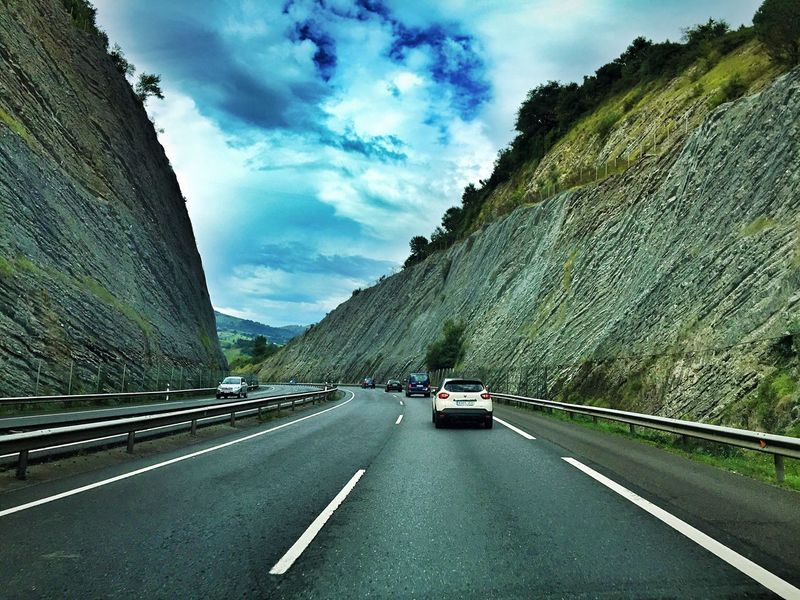 Transportation Road Car Road Marking The Way Forward Mountain Land Vehicle On The Move Sky Travel Mode Of Transport Cloud Diminishing Perspective Outdoors Travel Destinations Cliff Cloud - Sky Day Non-urban Scene Tranquil Scene Driving Trip Roadtrip SPAIN Road
