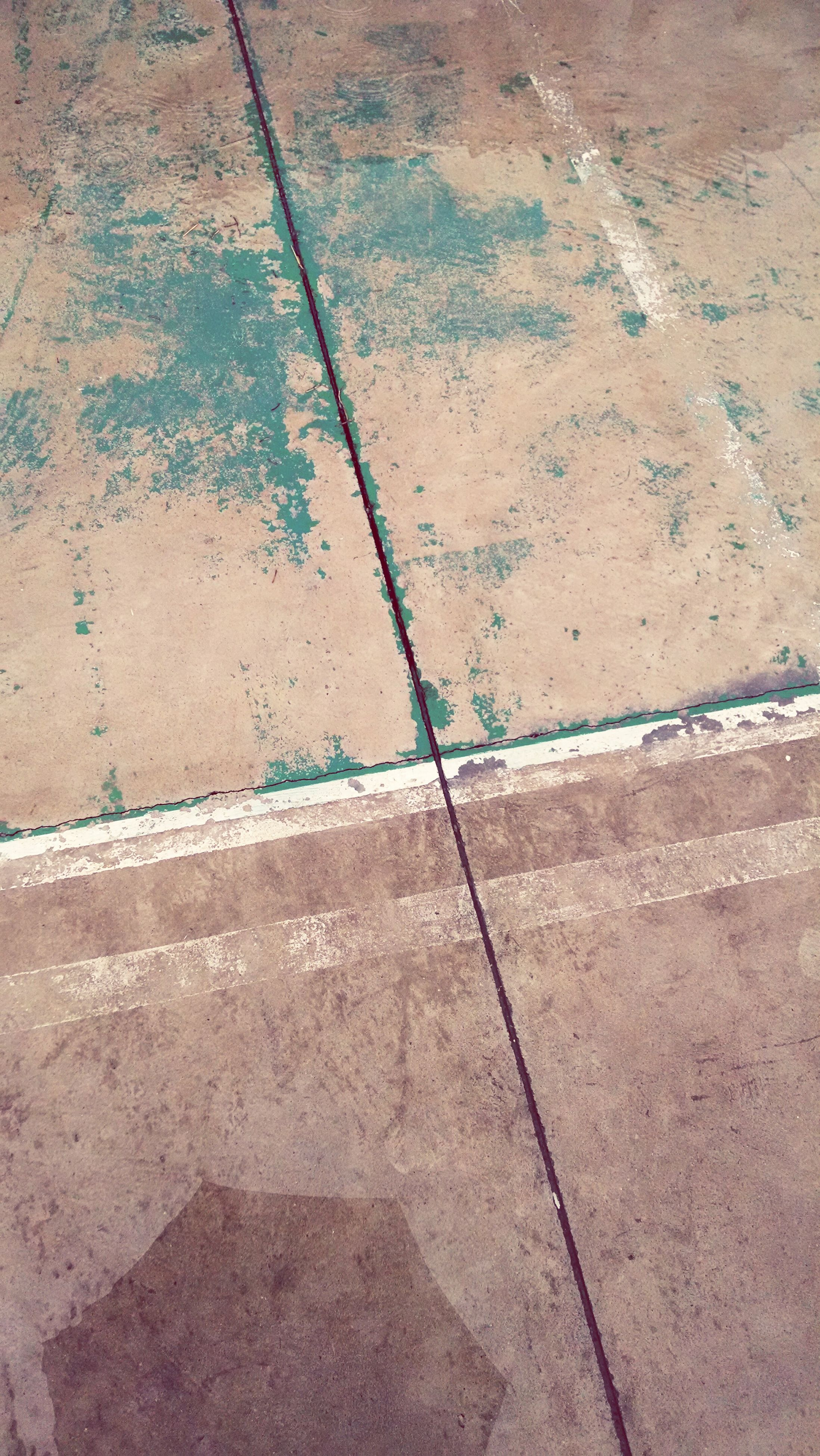 full frame, backgrounds, textured, pattern, wall - building feature, high angle view, close-up, built structure, no people, day, architecture, outdoors, wall, sunlight, cracked, detail, rough, concrete, geometric shape, blue