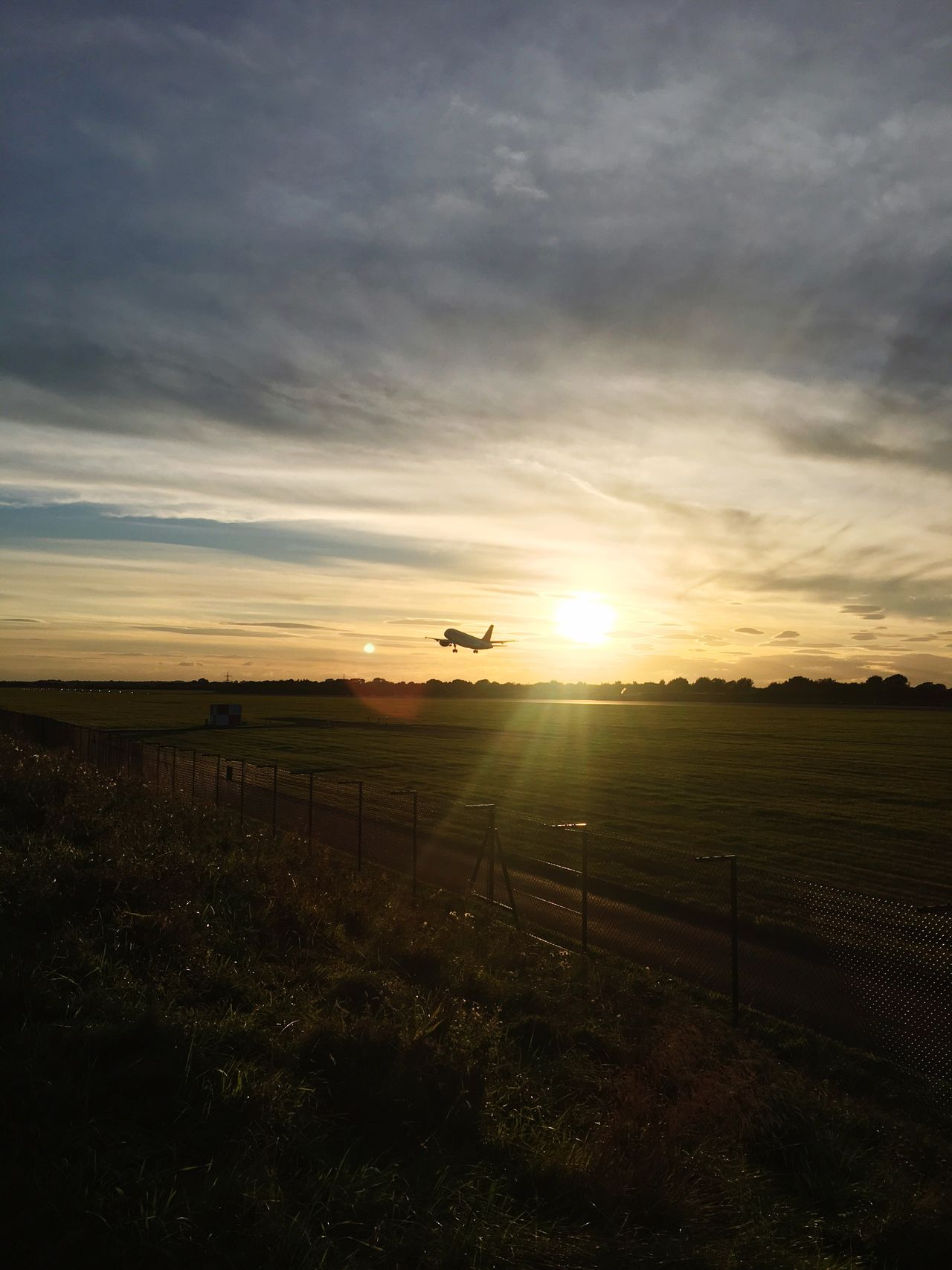 Landscape Sunset Field Tranquil Scene Tranquility Sun Sunlight Scenics Grass Rural Scene Beauty In Nature Horizon Over Land Sky Agriculture Nature Lens Flare Sunbeam Outdoors Crop  Farm Airplane