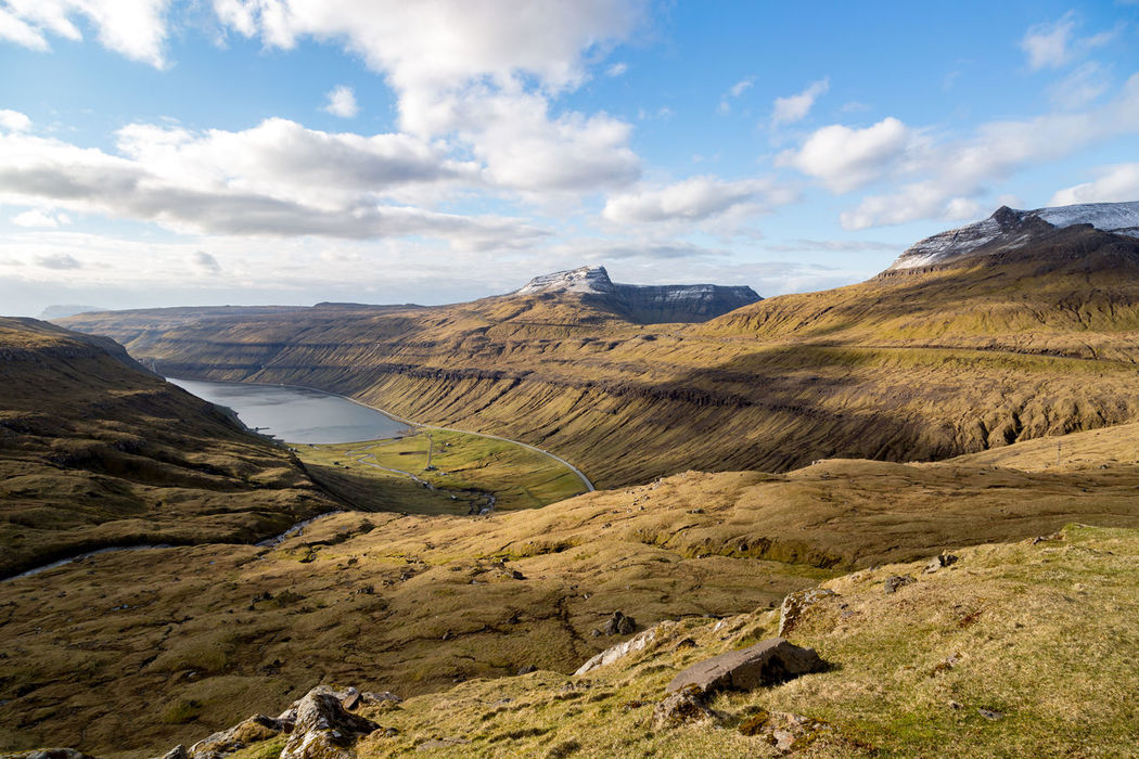 Travel Photos From the Faroe Islands Beauty In Nature Cloud Cloud - Sky Cloudy Day Faroe Faroe Islands Geology Grass Idyllic Islands Landscape Mountain Mountain Range Nature No People Non-urban Scene Outdoors Physical Geography Remote Rock Formation Scenics Sky Tranquil Scene Tranquility