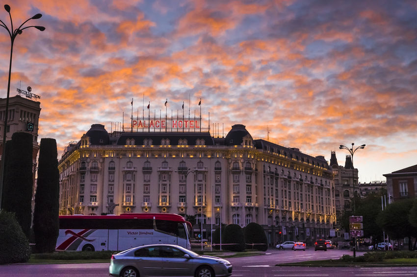 Sunset over a dark view of the Palace Hotel in Madrid. City City Street Cityscape Red Architecture Building Exterior Built Structure Car City City View  Cloud - Sky Evening Evening Sky Hotel Land Vehicle Nature Outdoors Palace Hotel Red Clouds Sky Sunset Tourism Transportation Travel Travel Destinations